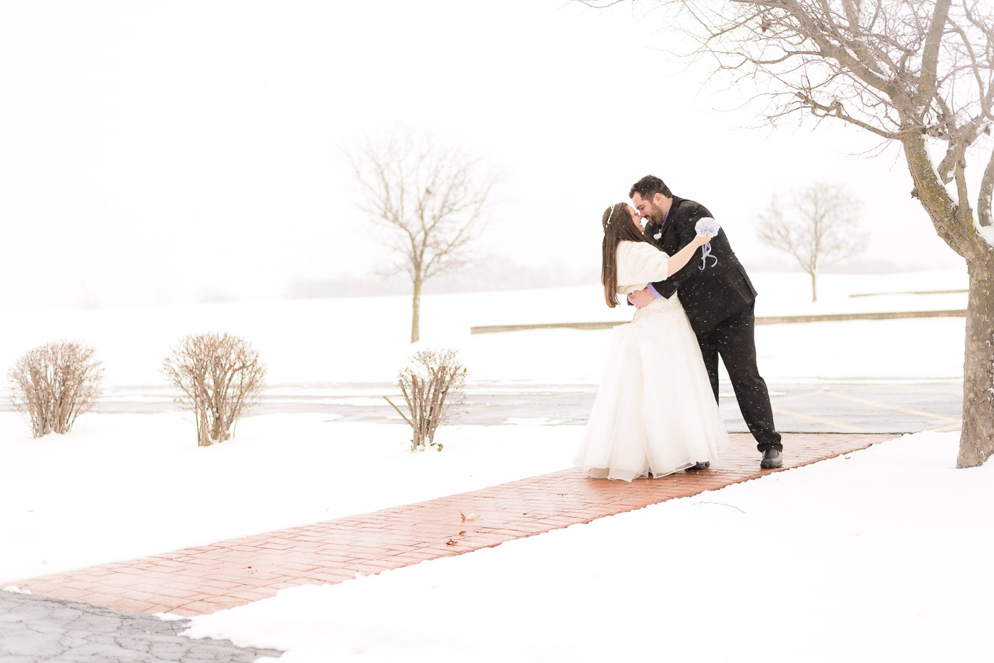 Newlywed Couple Embracing for Kiss in the Snow