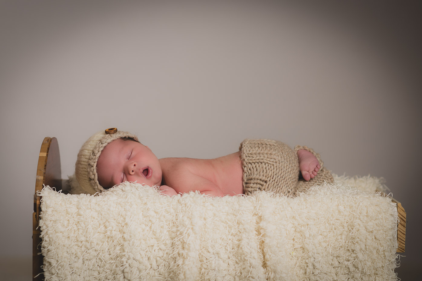 Adorable sleeping newborn with mouth open