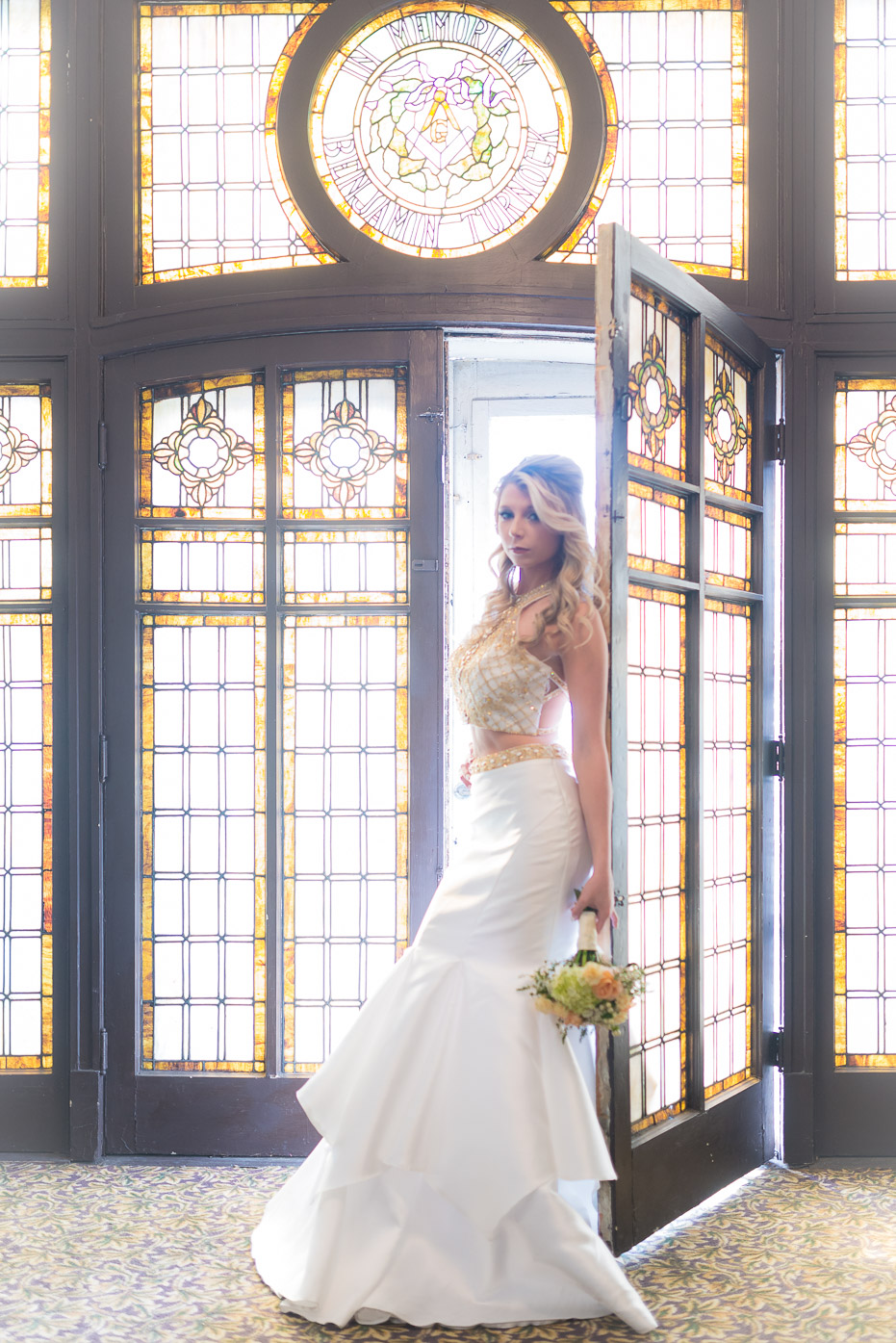 Stunning bride with bouquet with stained glass