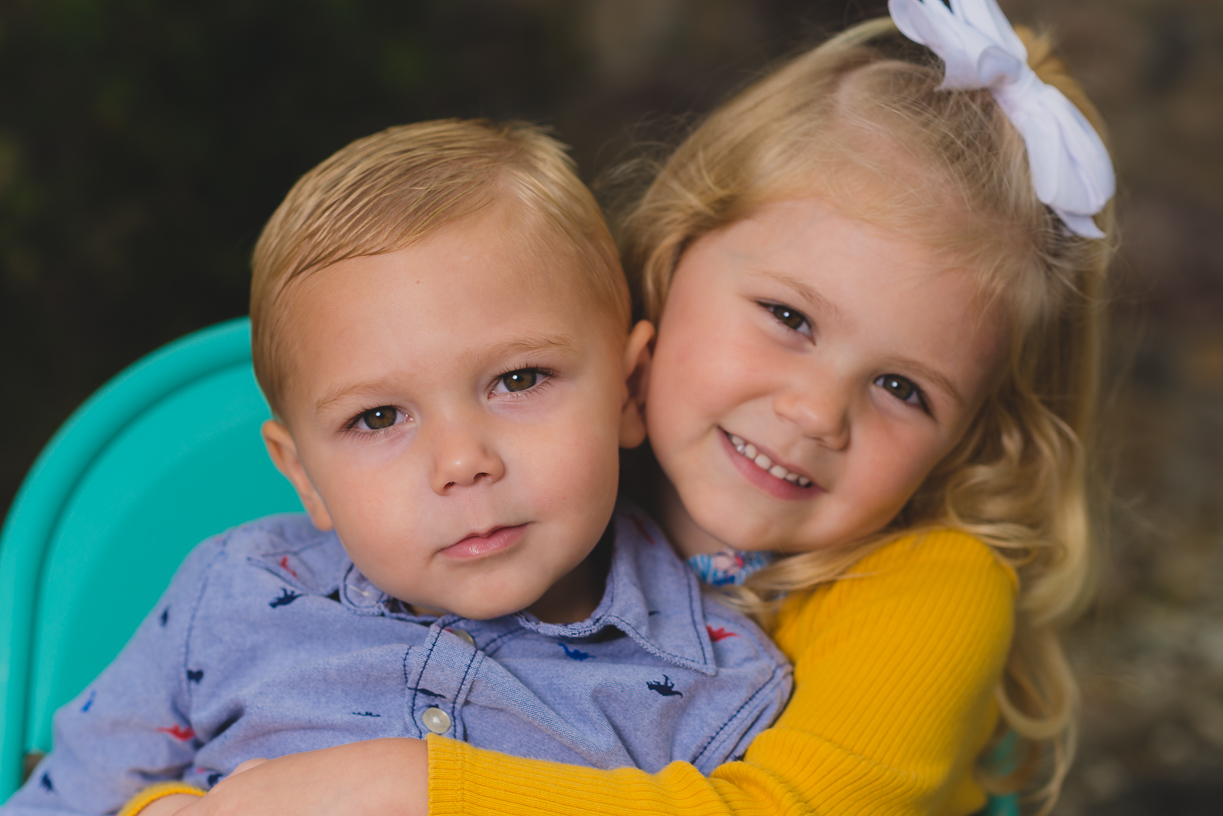 Grandkids boy and girl hugging