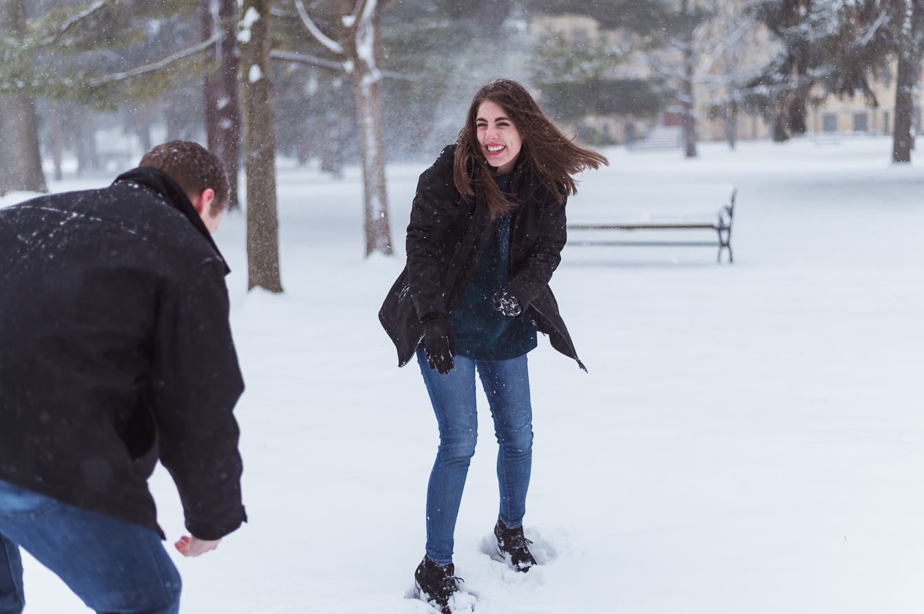 Snowball fight flirting couple