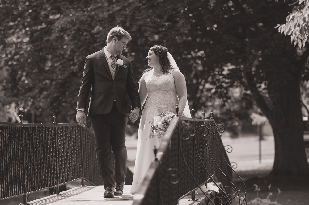 We were able to capture a little quite time spent between these newlyweds as they crossed the iconic bridge on the campus of St. Mary's College in Notre Dame, Indiana