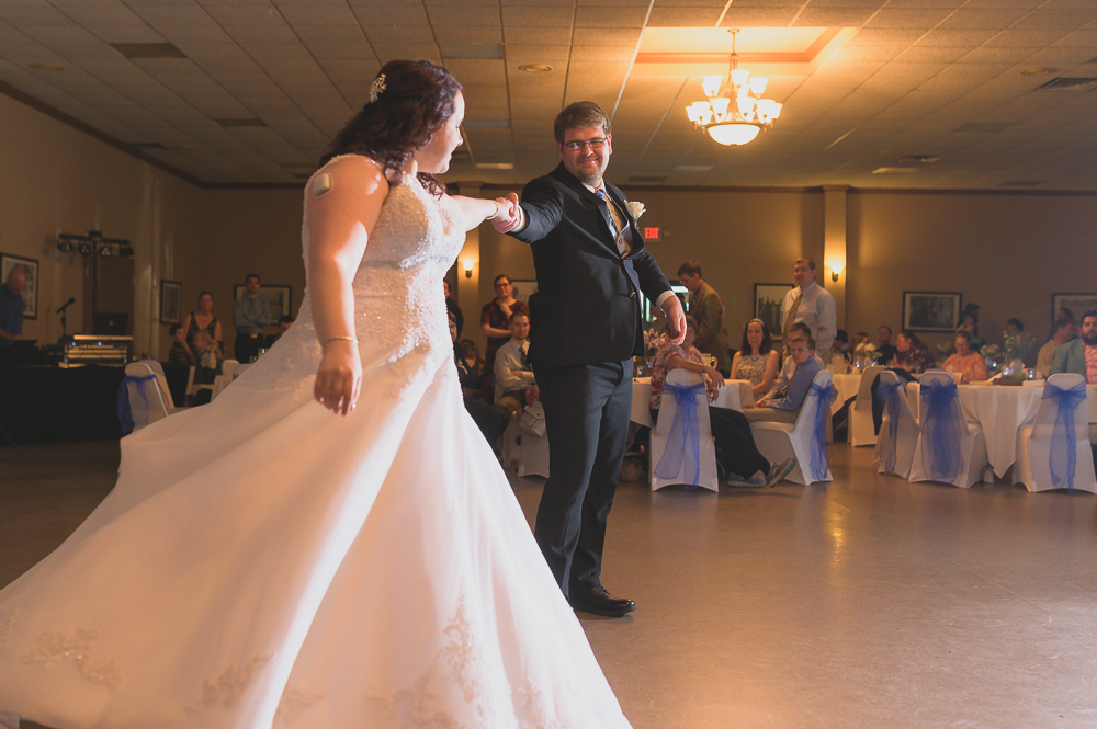 Wedding reception photo of dancing bride by South Bend wedding photographer