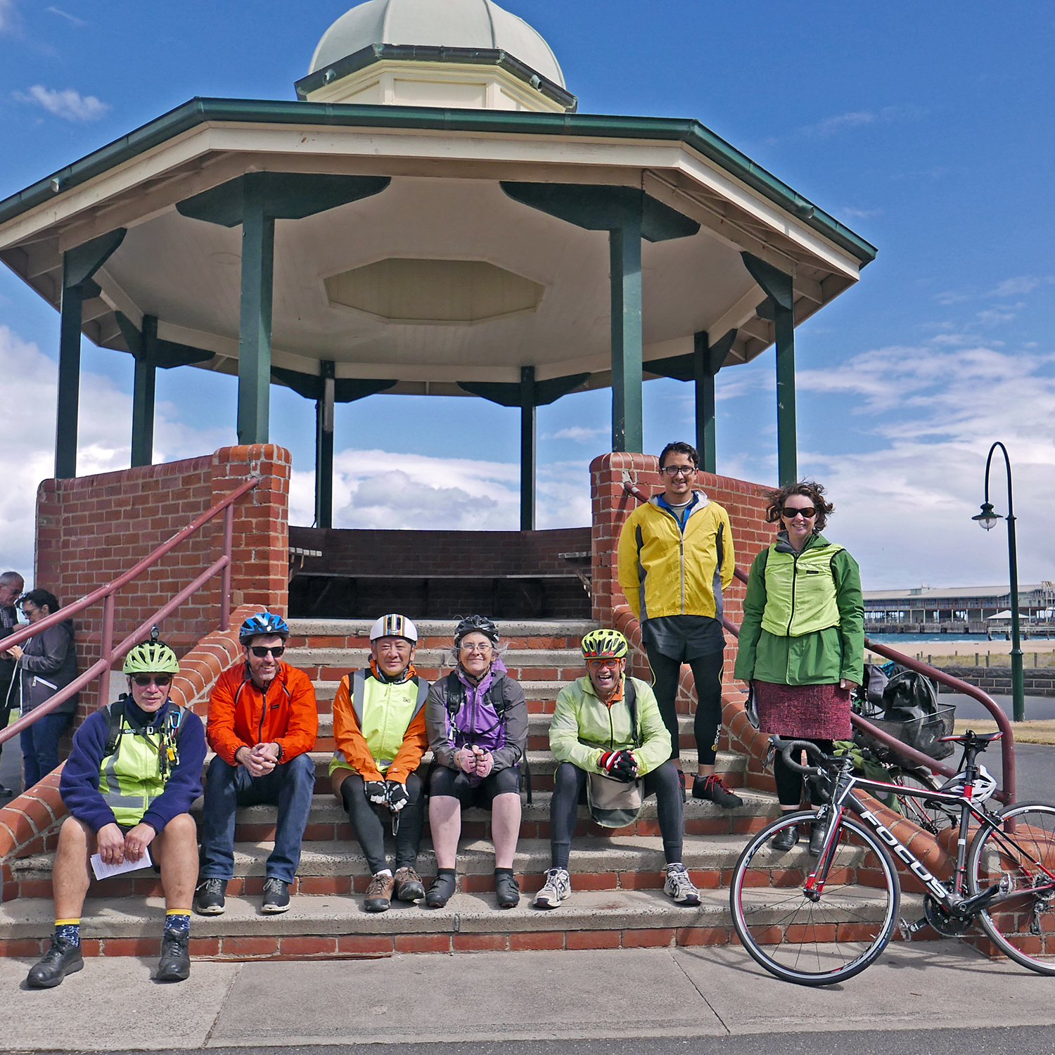 Despite the chilly temperature, strong winds and looming grey clouds, we were lucky to get sunshine to ride in. Here we are starting at the Port Melbourne Rotunda.