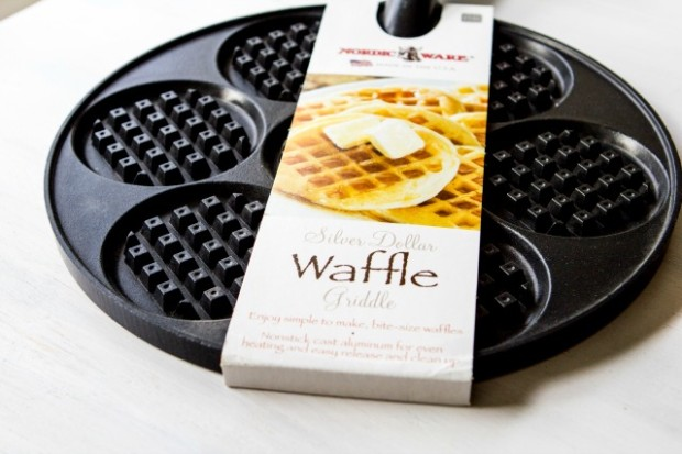 THIS PAN  I've been totally freaking over waffles lately. They're all I want to eat. Like, all the time.  I want waffles for breakfast and waffles for dinner. I want waffles for dessert and waffles at midnight, when I should be sleeping instead of thinking about waffles.  This is a hard obsession to obsess about, when you've gone and given up gluten, beans, flours, and other stuffs that tend to make good waffles. Paleo breakfast foods typically use a magical combination of fibrous bananas and eggs to make crepes and pancakes. But put that batter into a waffle pan and you've just got a bubbly mess.  At least, that's what happened until I discovered two paleo-fabulous finds at Harmons this week. (Mantra break: Forgive me Father, for I am just now coming to appreciate my local Harmons for the gourmet grocery goodness that it harbors inside).  So, this pan. This  NordicWare Silver Dollar Waffle Griddl e now makes waffles simple, easy, and in totally perfect sizes. When I say I want a waffle, I don't really want a whole, goddamned waffle. I just want three bites. Three bites of nom, three bites of syrup. And in proper cases, three bites of bacon.  Most waffle irons are too big to give me what I want. They're just behemoths in the world of breakfast food. And thus I've left my waffle iron withered and lonely in the back pantry for sometime now.  But this pan officially changes everything. It heats evenly, makes teeny waffles, and stored itself simply with my other pans. (Mantra break: Oh, Silver Dollar Waffle Griddle, j'adore.)