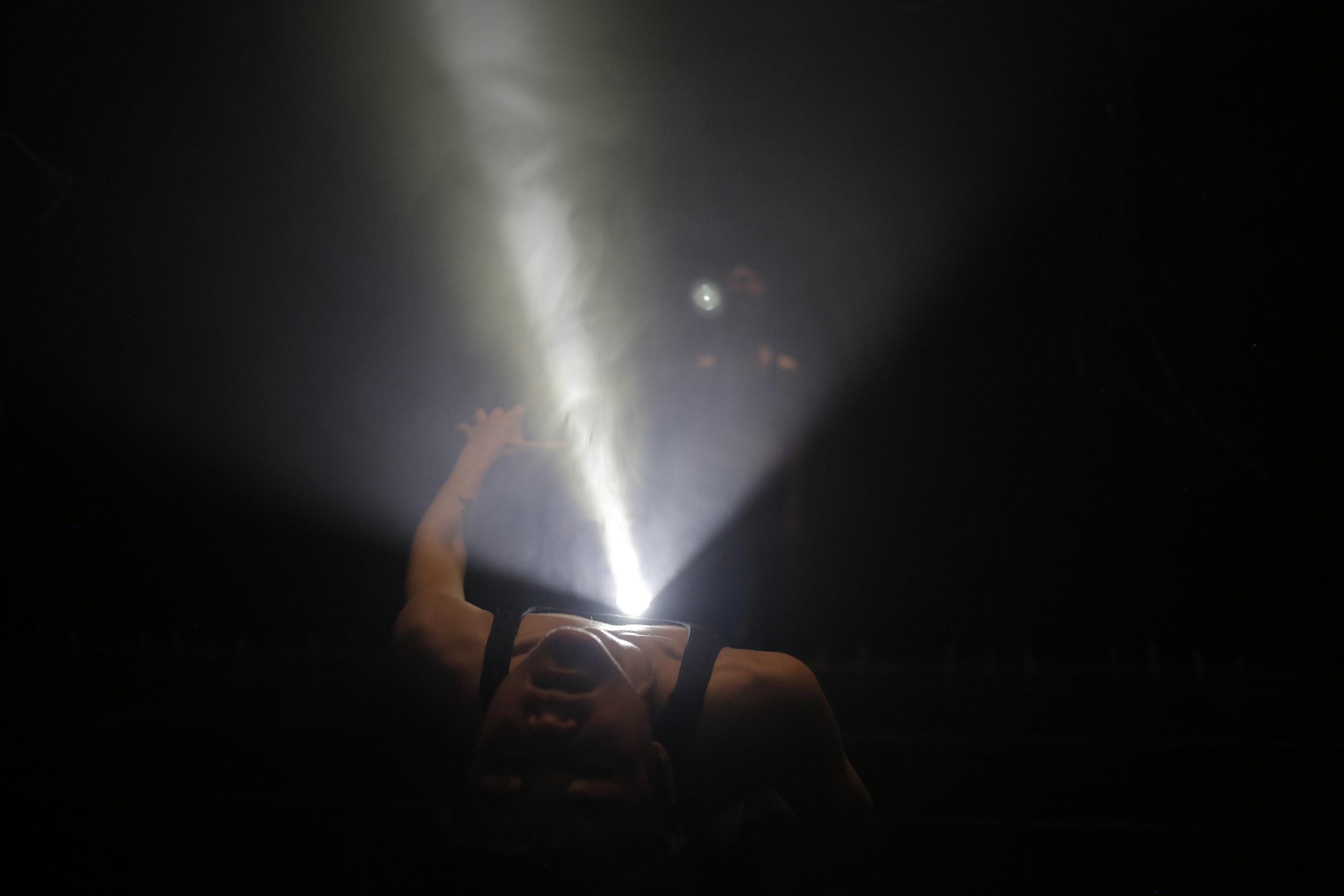 Brenna-leaning-back-with-flashlight.JPG