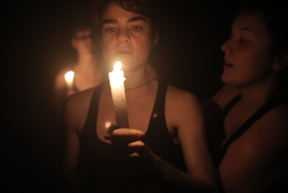 Brenna_holding-candle_CROPPED.png