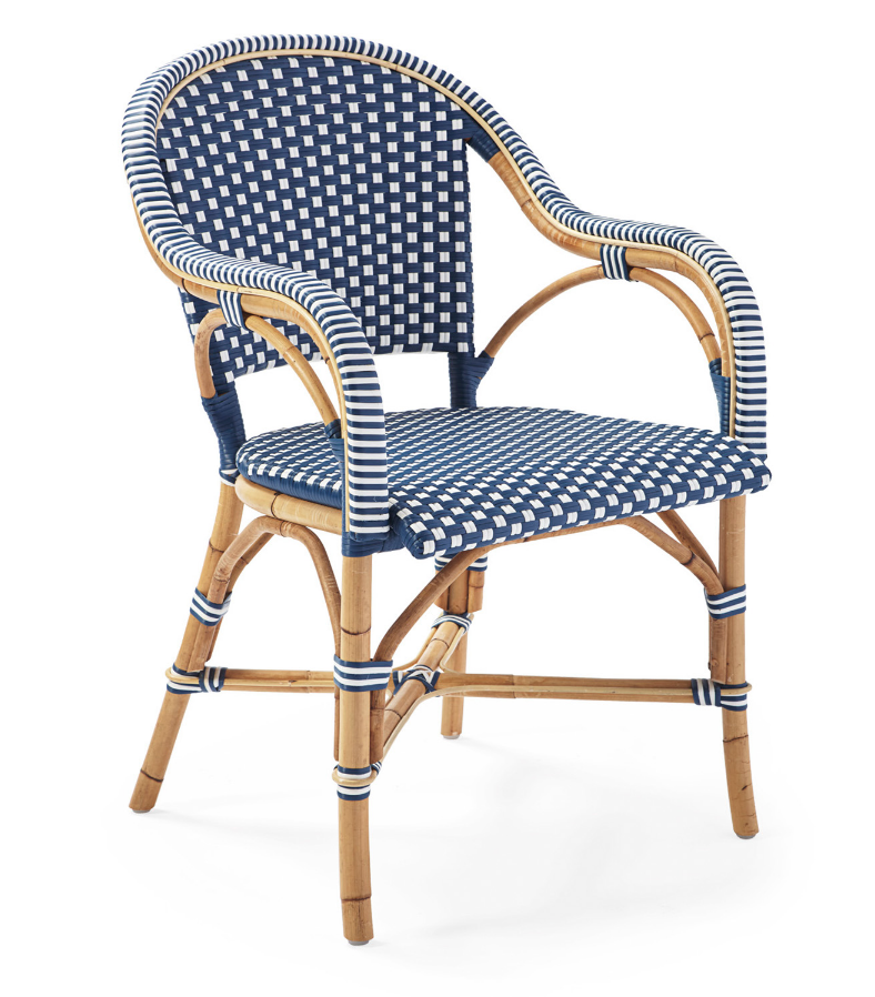 Splurge - This reinterpreted bistro chair by Serena and Lily is made of rattan and woven plastic.  While it does have a beautiful finish, the downside is that it has to be stored indoors, so take that into consideration if you want to use these outside. Find them here for $298.