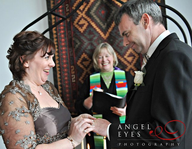 Rev. Rebecca with wedding couple; photo by Hilda Burke of AngelEyes Photography