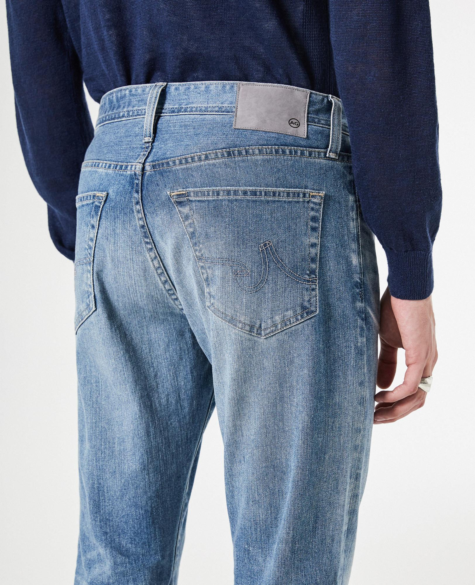 Girl wears short skirt made of jeans that covers her big ass
