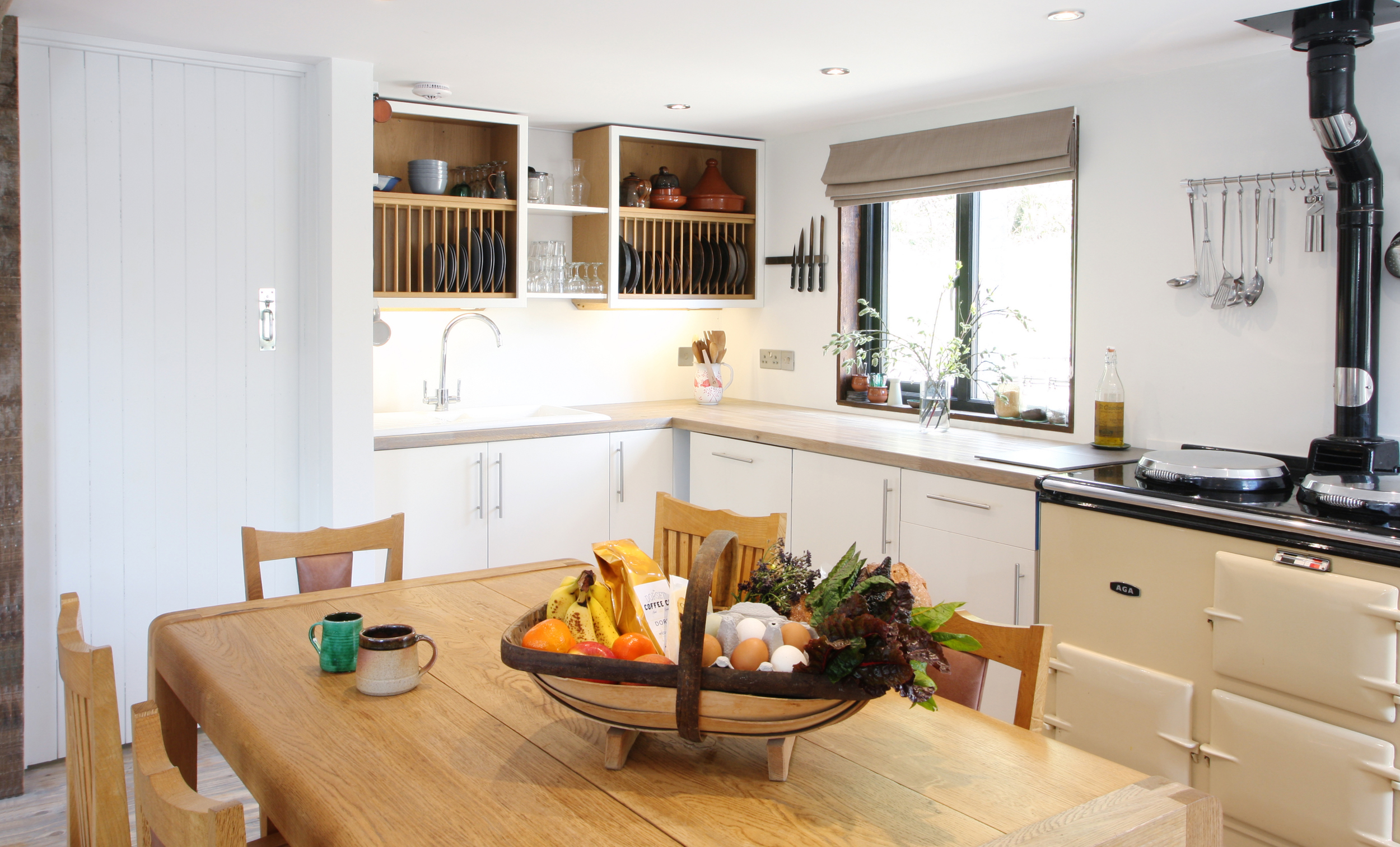The Kitchen dining area with Aga and Radius Table by  Simon Pengelly  is a welcoming space to return to and enjoy creating fantastic meals from fresh local produce.