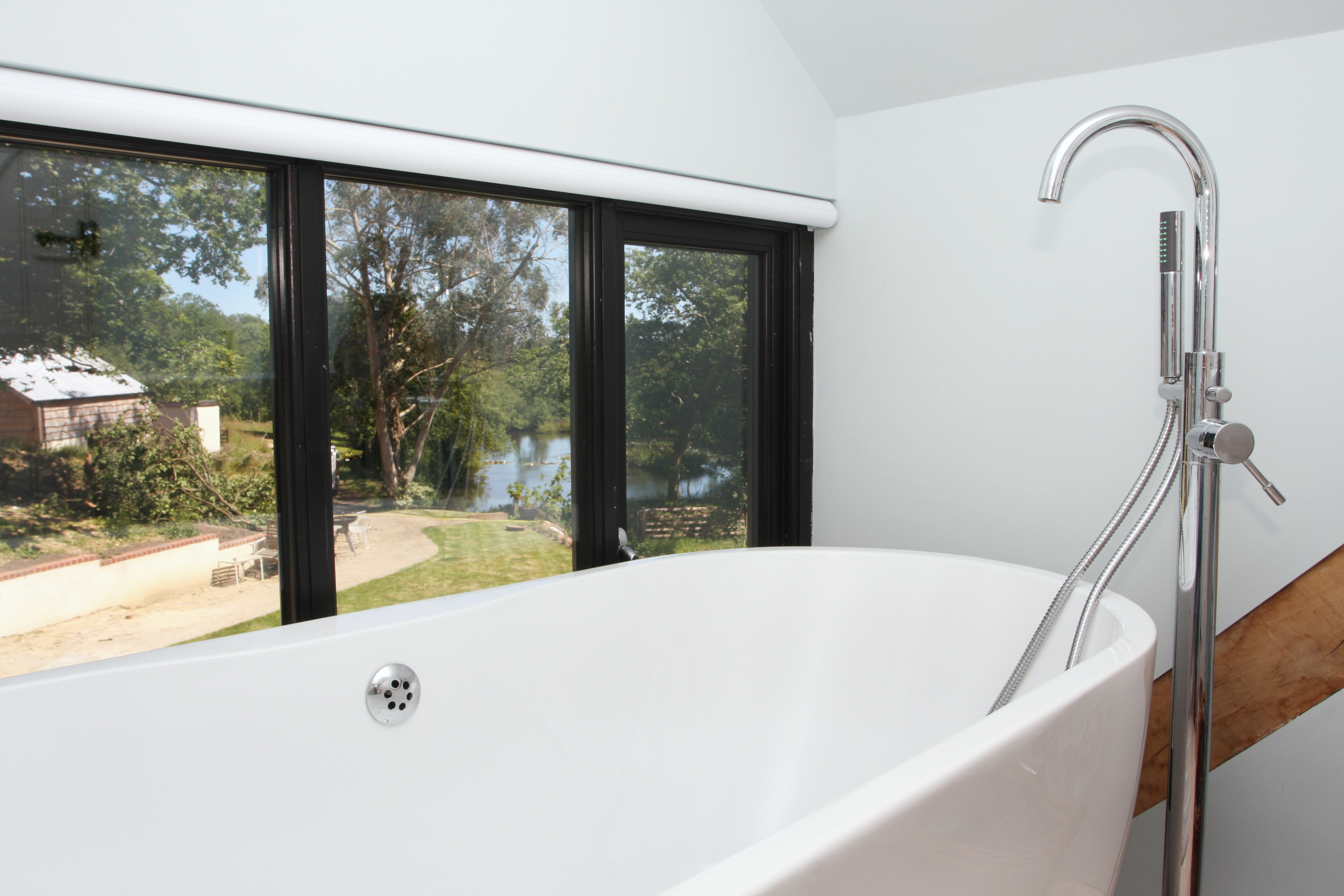 Upstairs bathroom with view towards the lake.