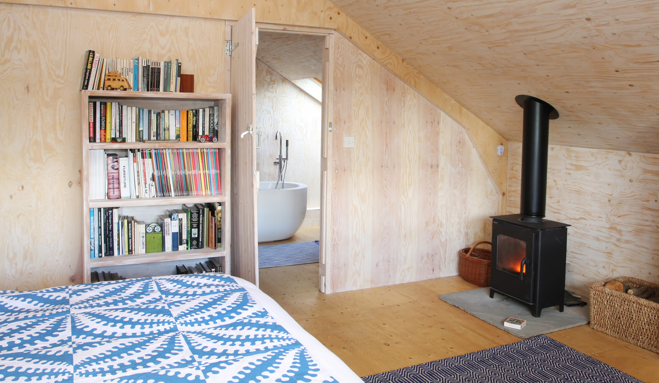 The en-suite bathroom has a freestanding bath positioned below a skylight, the wood-burning stove offers a romantic glow at any time of year.