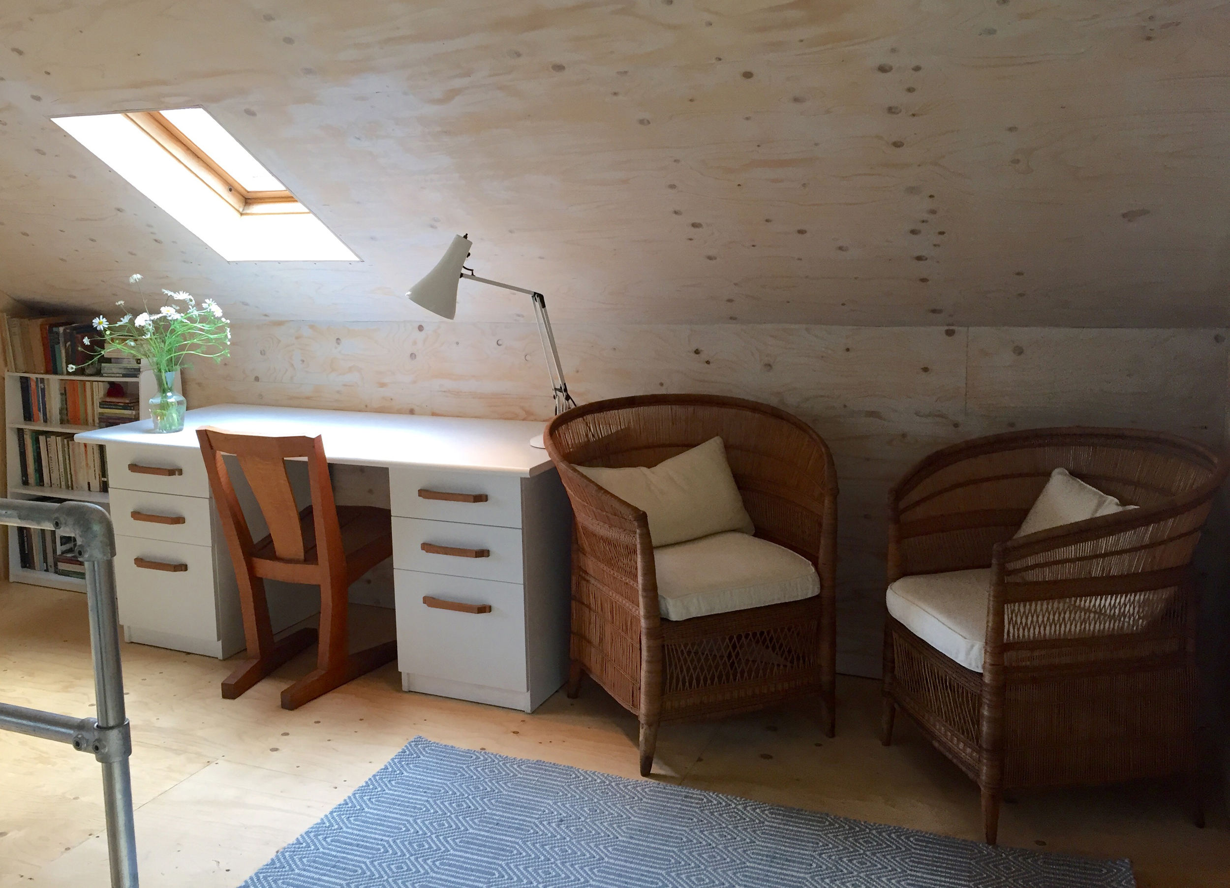 The landing with vintage desk and cantilevered oak chair by  James Verner  makes a great place for reading and writing; there's also a discrete alcove in which we've put an extra double bed.