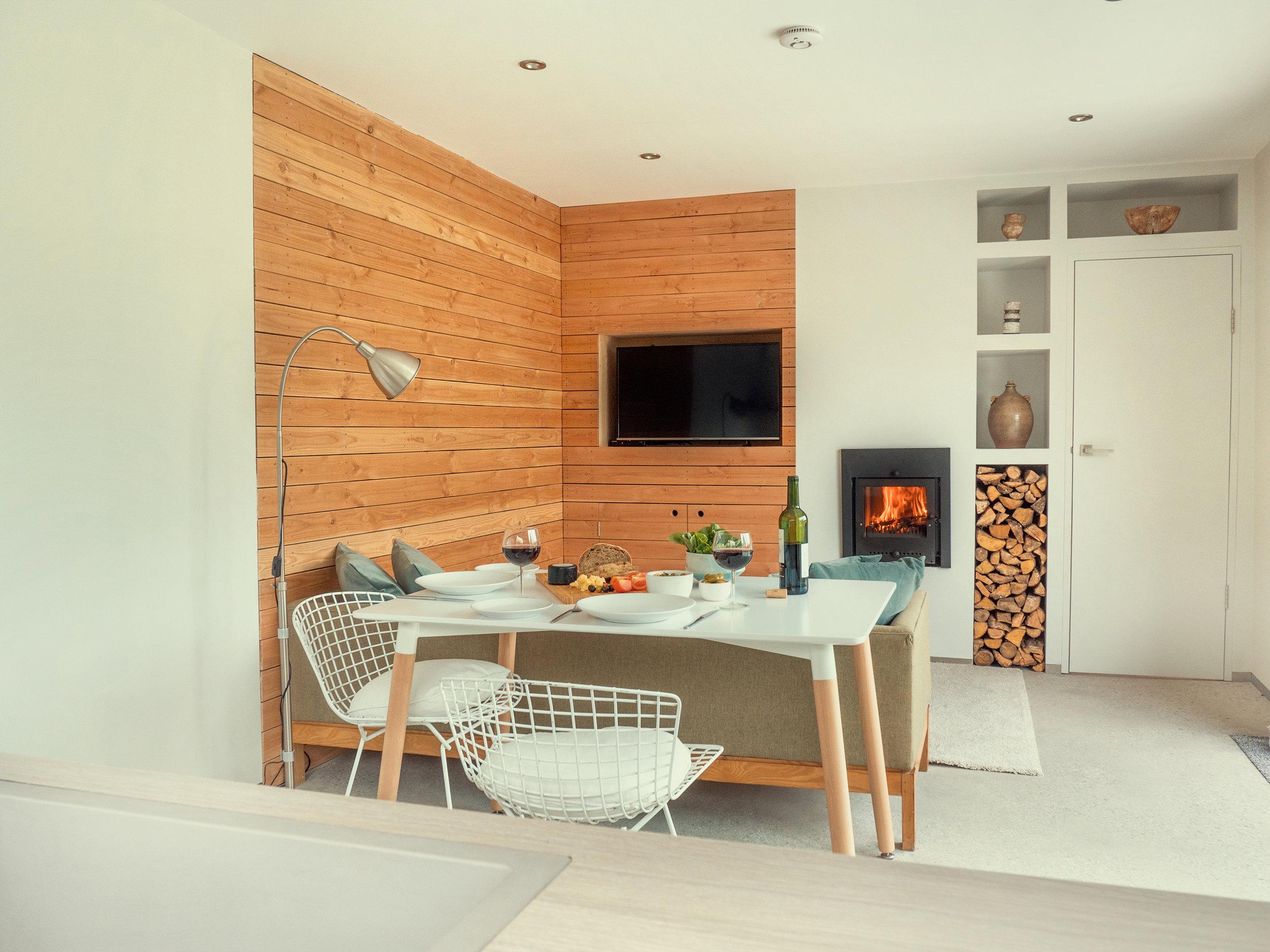 Enter via reclaimed aluminium sliding doors into the open plan living space .