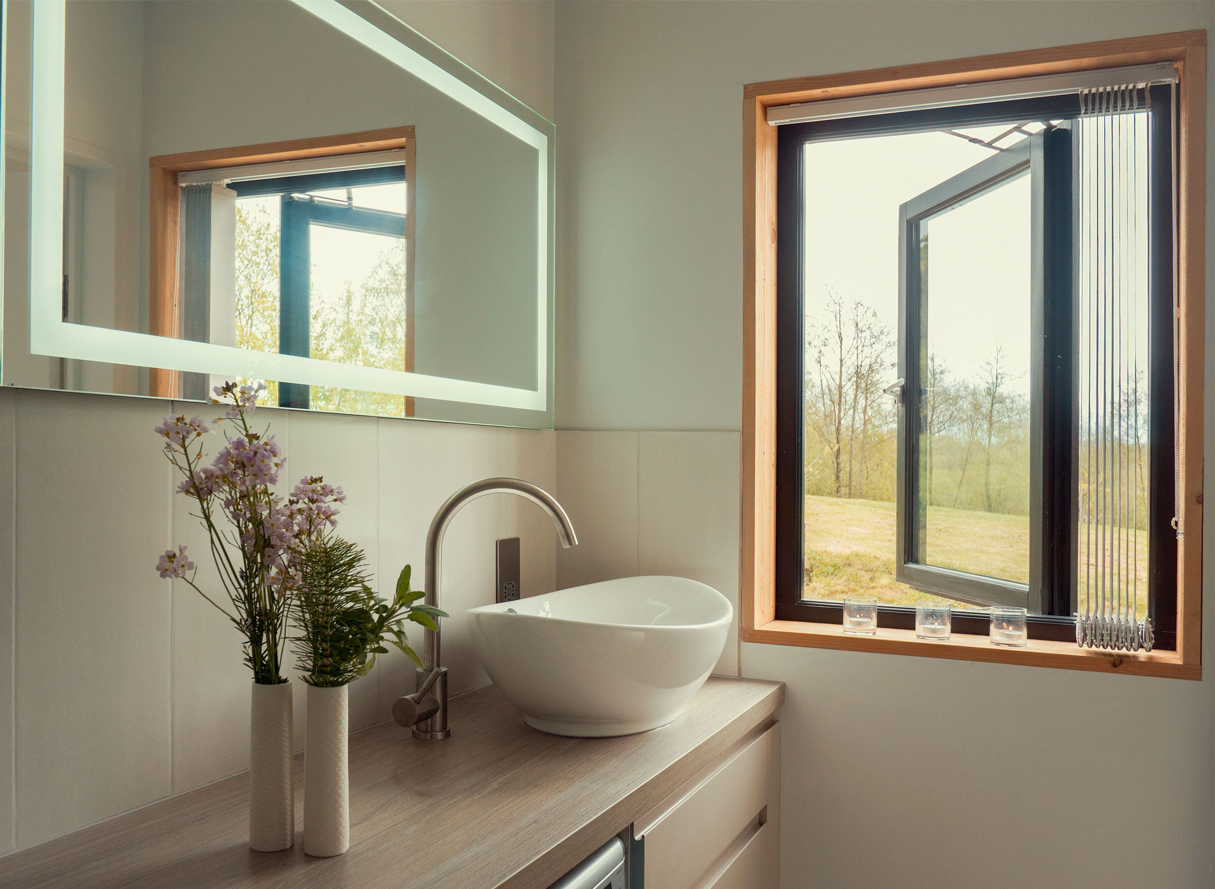 The shower room is en-suite, with a large walk in shower, WC, illuminated de-misting mirror and countertop basin.
