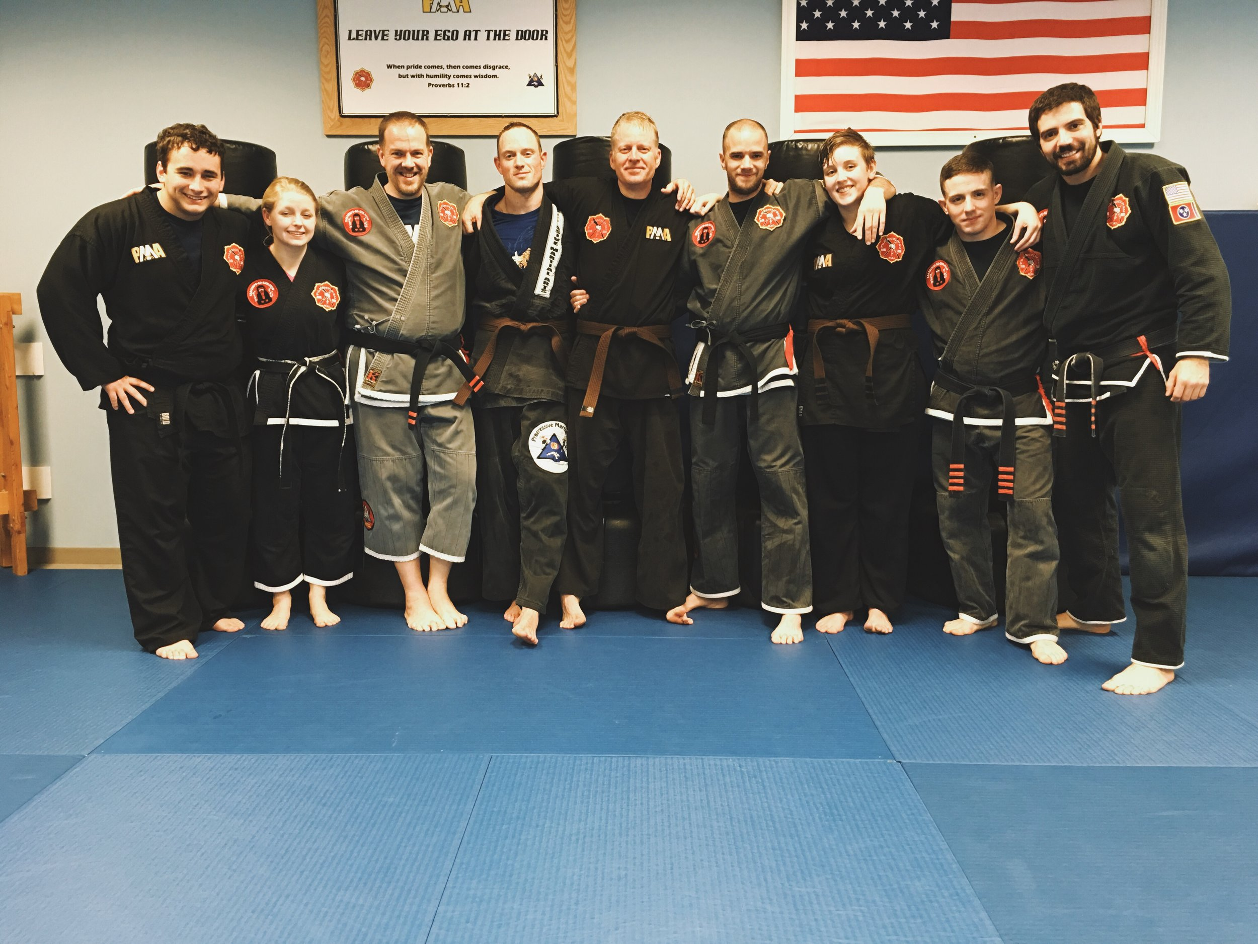 Gary (pictured in middle) with some of his instructors and training partners at Progressive Martial Arts Academy.