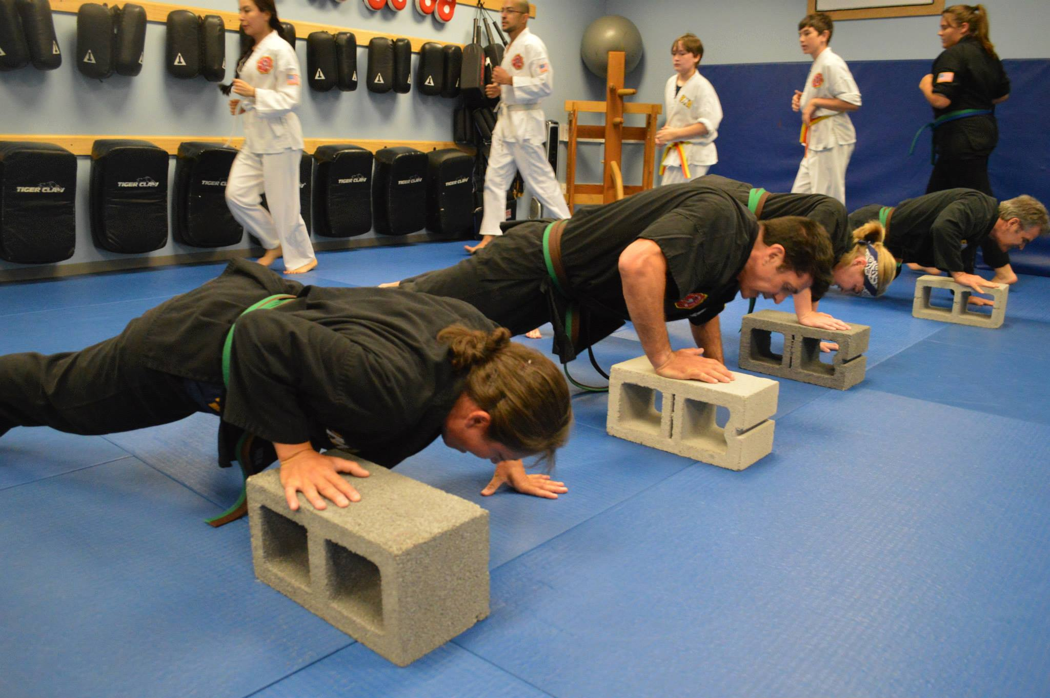 Linda performing a push up exercise with cinderblocks.