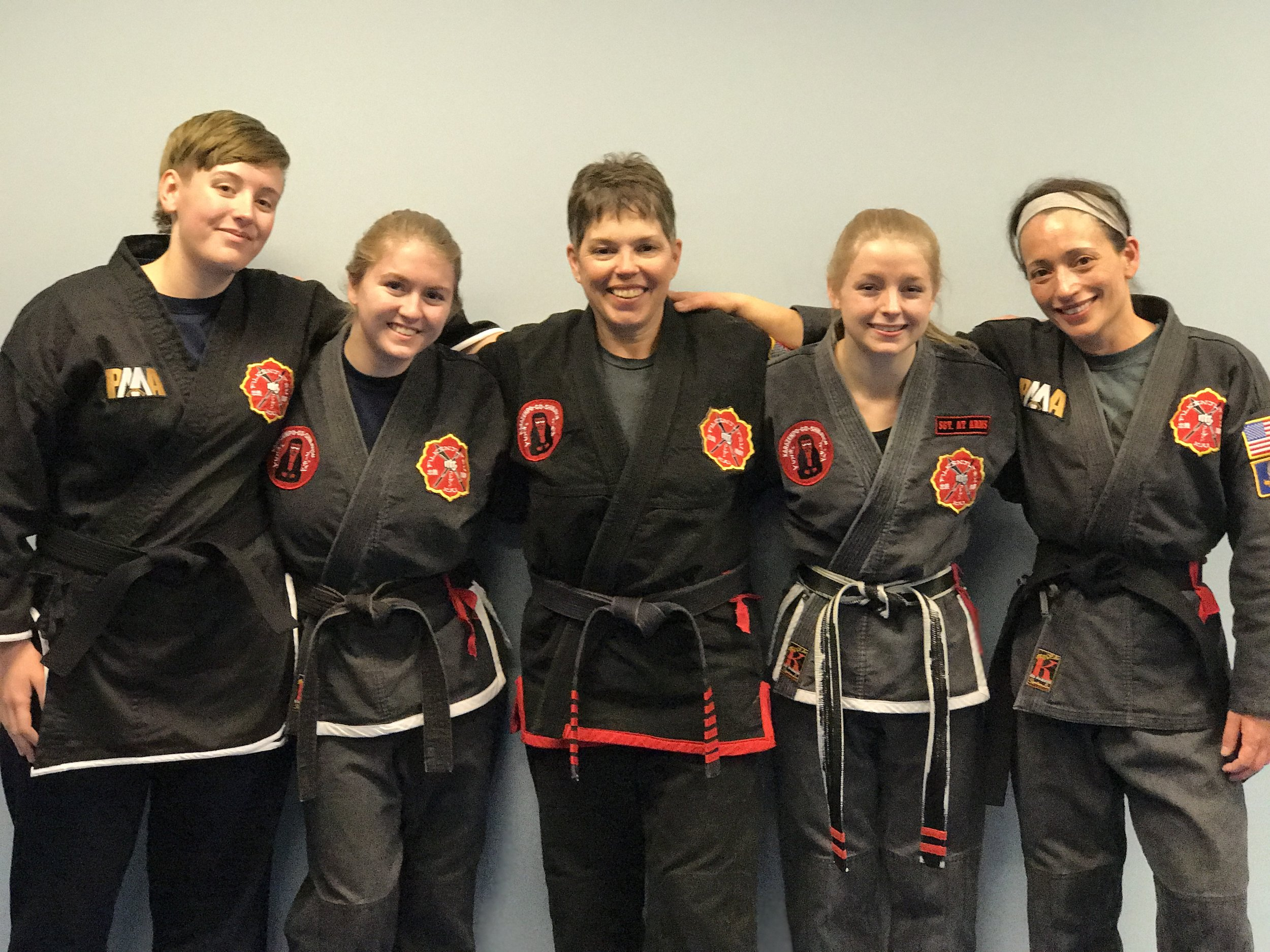 On February 19, 2017, Linda became the 5th female FILKENJUTSU Black Belt. Pictured from left to right: Olivia Cannon, Gracie Hall, Meg Corrigan, Madelyn Fowler, and Linda Davis.