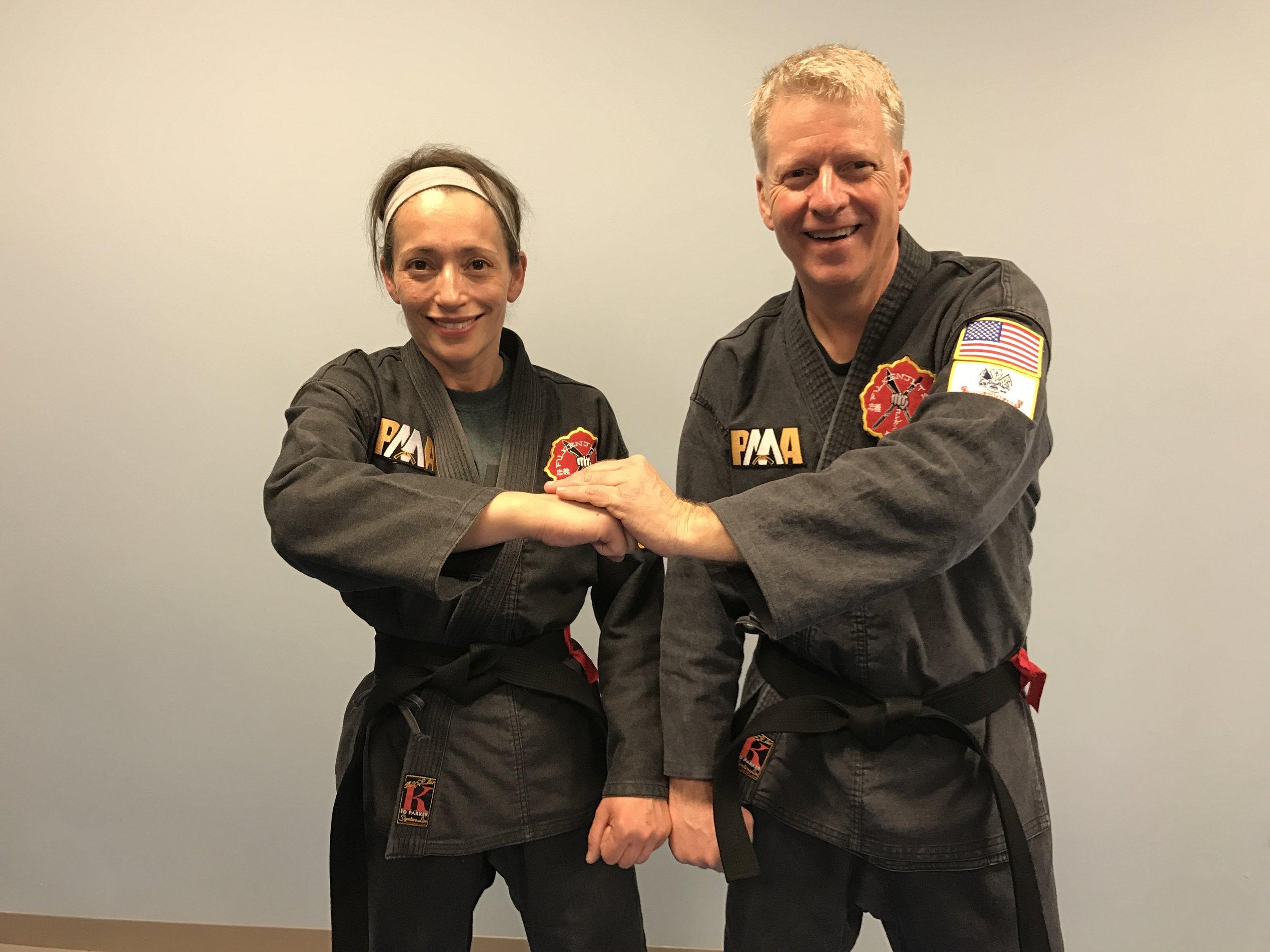 Linda with her Black Belt Test partner, Gary Hall.