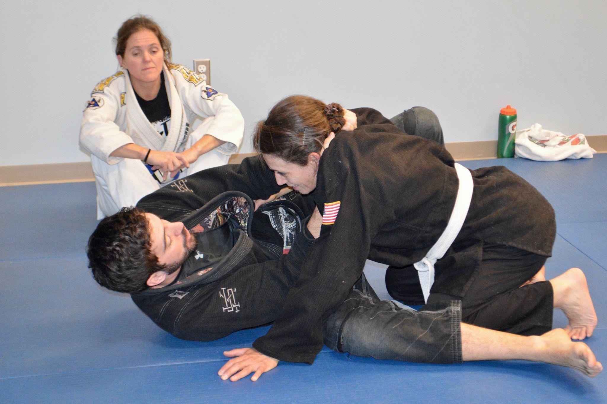 Linda learning a Jiu Jitsu technique from her teacher.