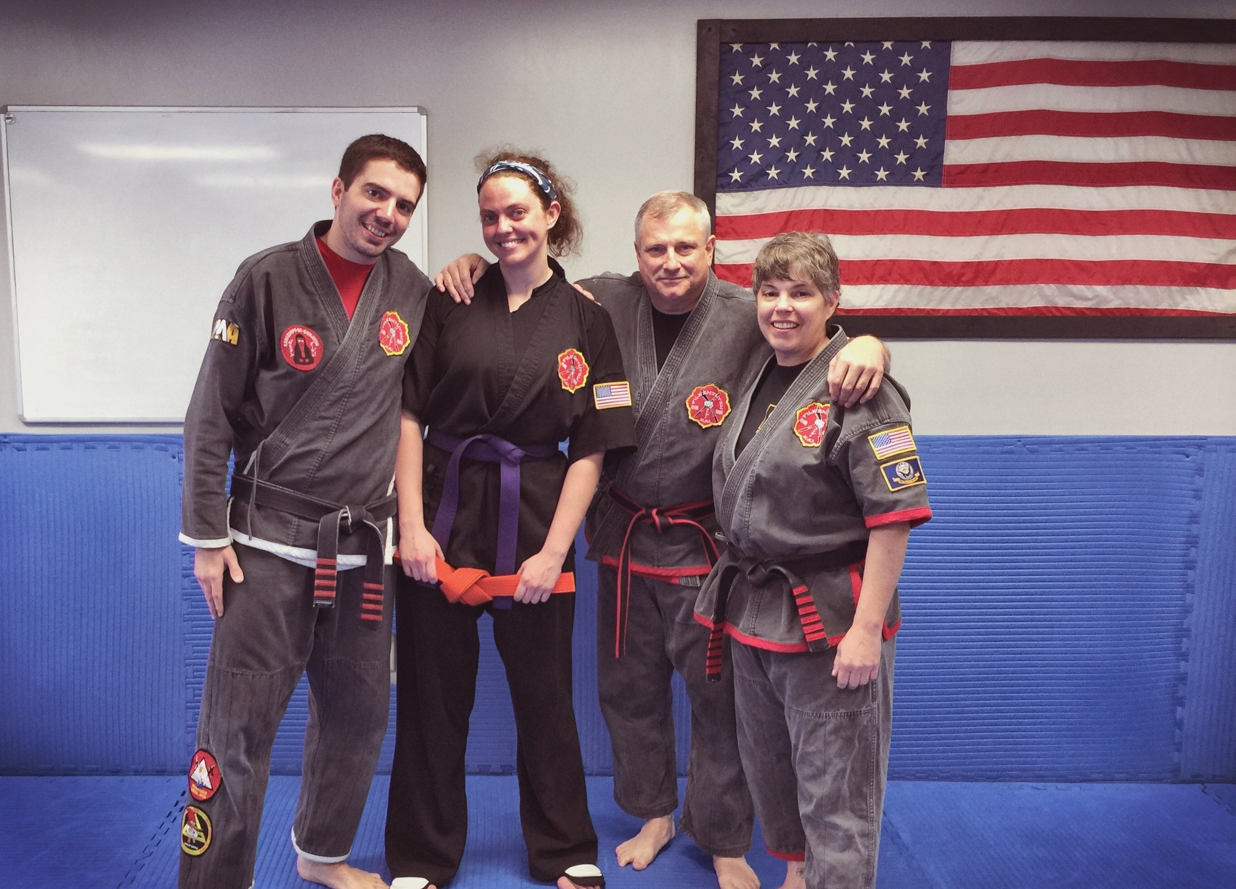 Brittany began her Kenpo training under the founder of PMA and FILKENJUTSU, SiJo Bruce Corrigan. Here she is after earning her purple belt in Kenpo, alongside her husband (SiFu David Corrigan), father-in-law (SiJo Bruce Corrigan), and mother-in-law (SiGung Meg Corrigan).