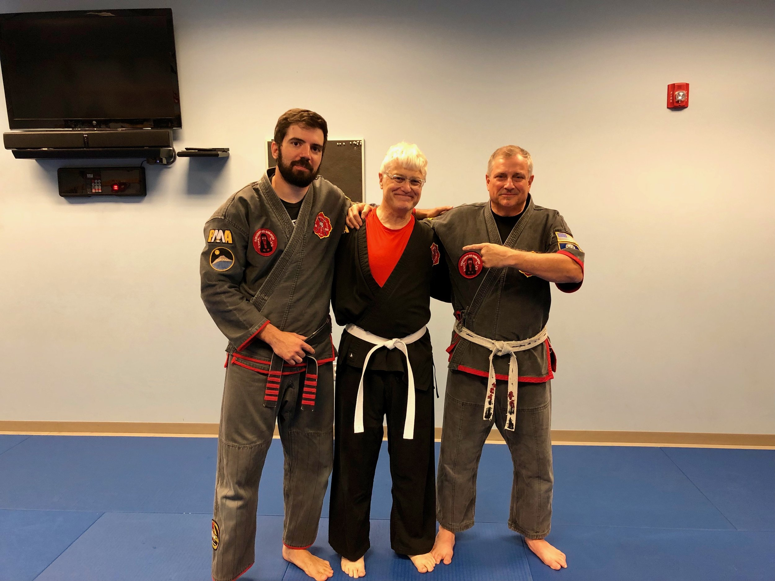Bill on the day he was selected as a Black Belt candidate in FILKENJUTSU Kenpo. Pictured alongside SiFu David Corrigan and SiJo Bruce Corrigan.