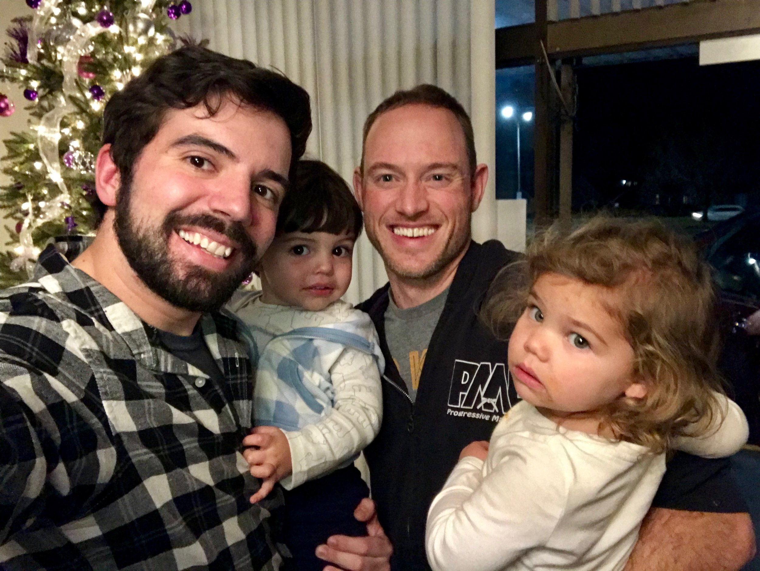 Sempai Matt and his daughter, Wylie, alongside his instructor, David Corrigan, and his son, Auggie. Wylie and Auggie shared the same due date!