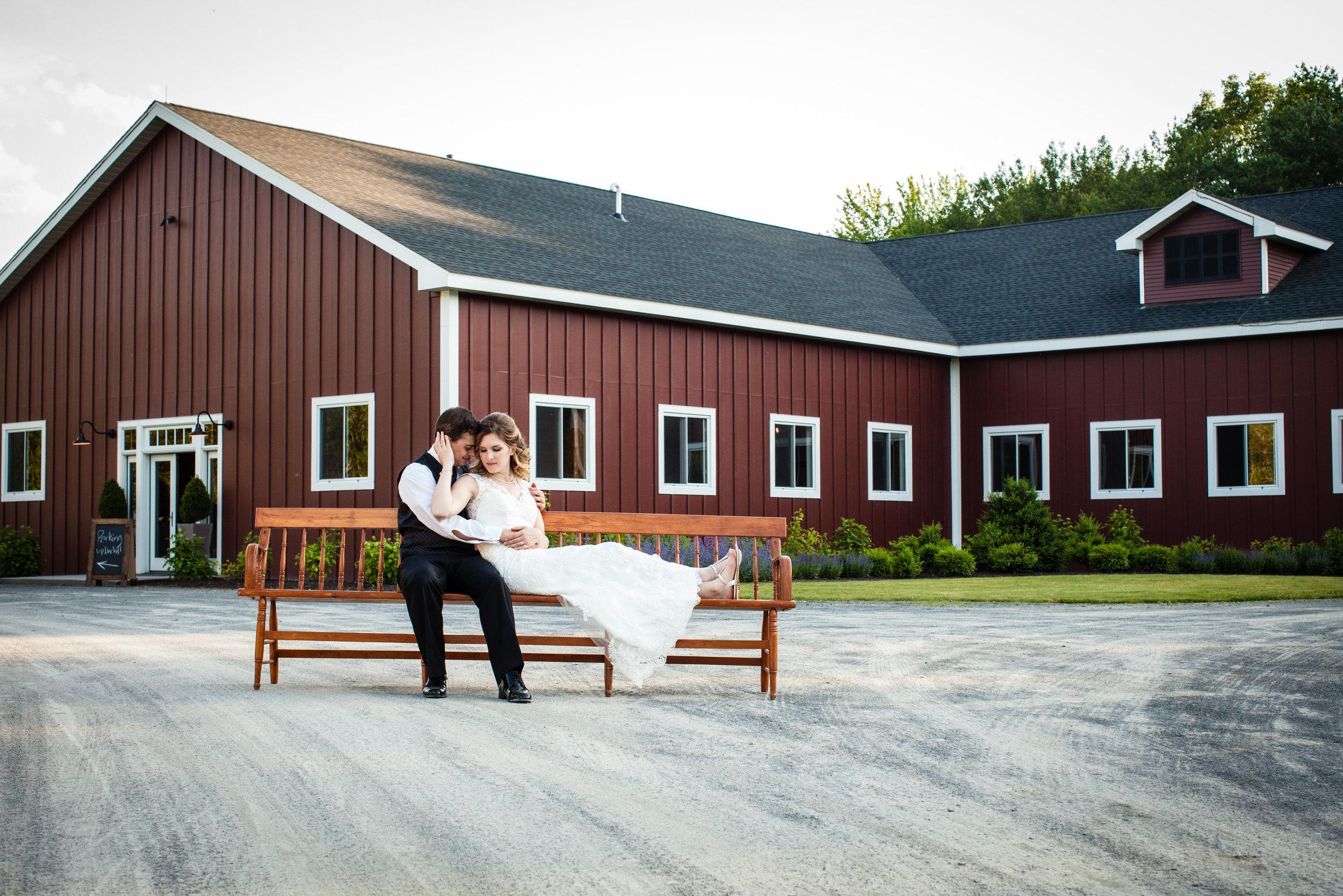 B+G on bench in front of barn.jpg