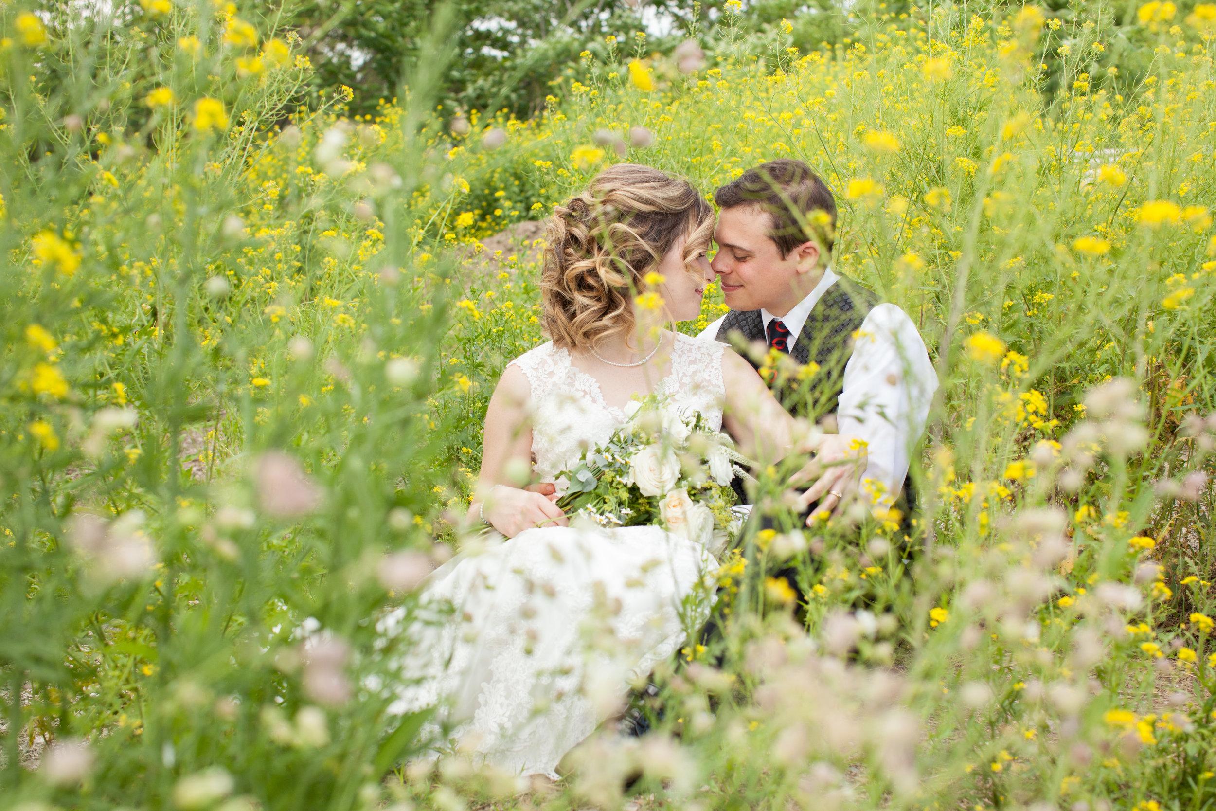 Bride and groom in the flowers.jpg