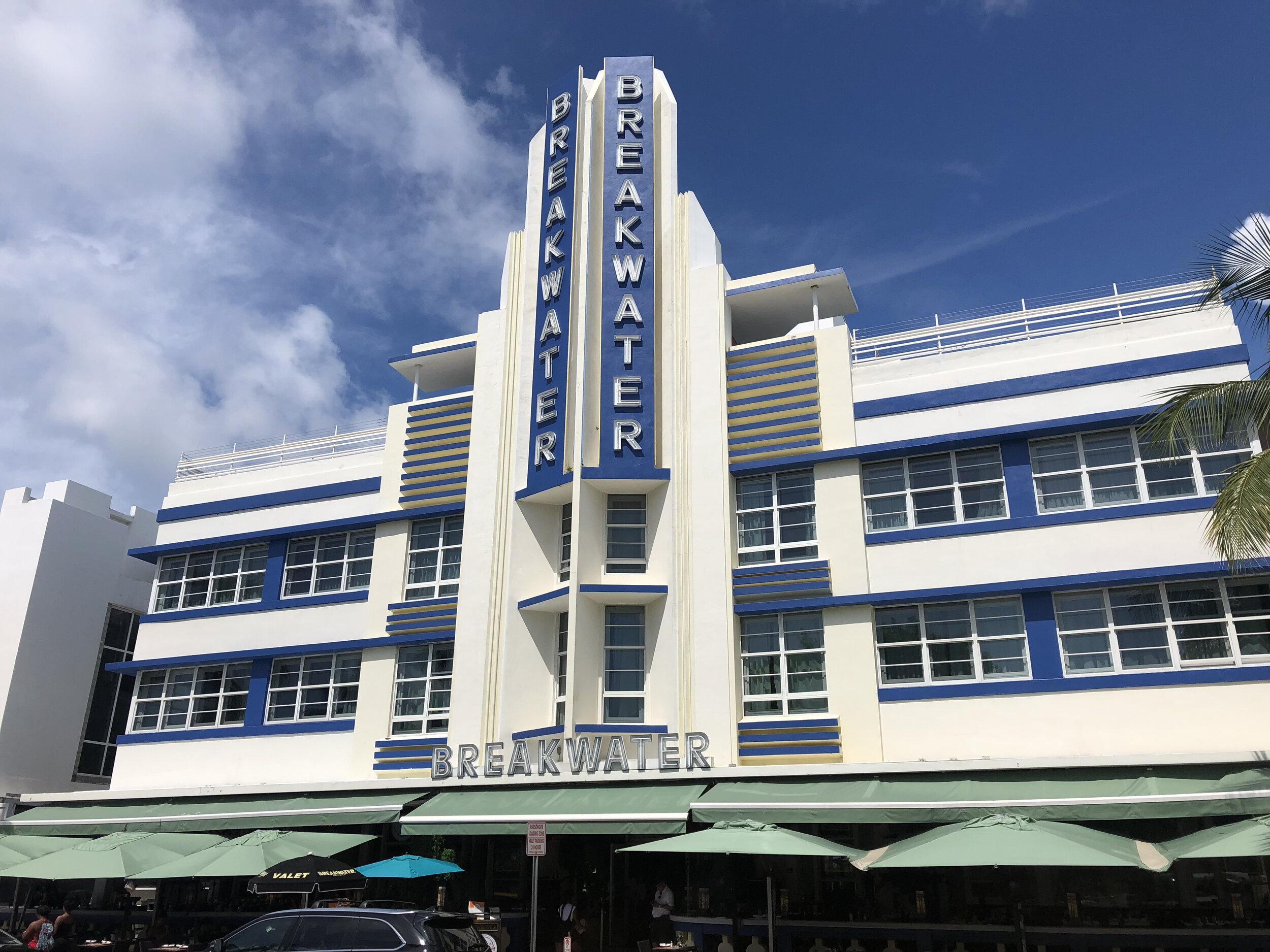 Opened in 1936, The Breakwater is pure Art Deco, with an emphasis on symmetry and clean, colorful lines. Designed by Anton Skislewicz, the hotel's electric blue and neon-lit central tower epitomizes Miami Beach.