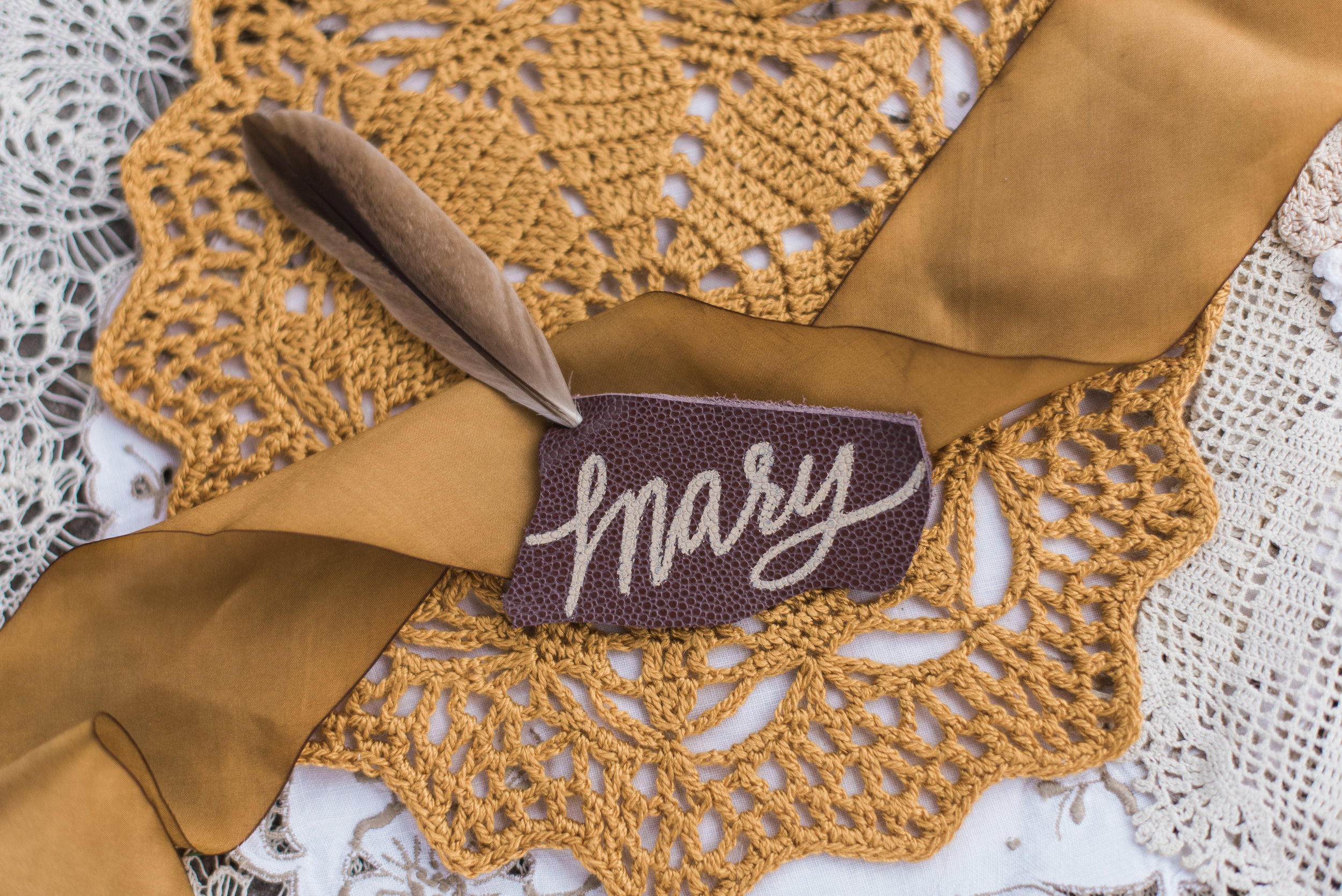 Hand lettered Feather Placecard