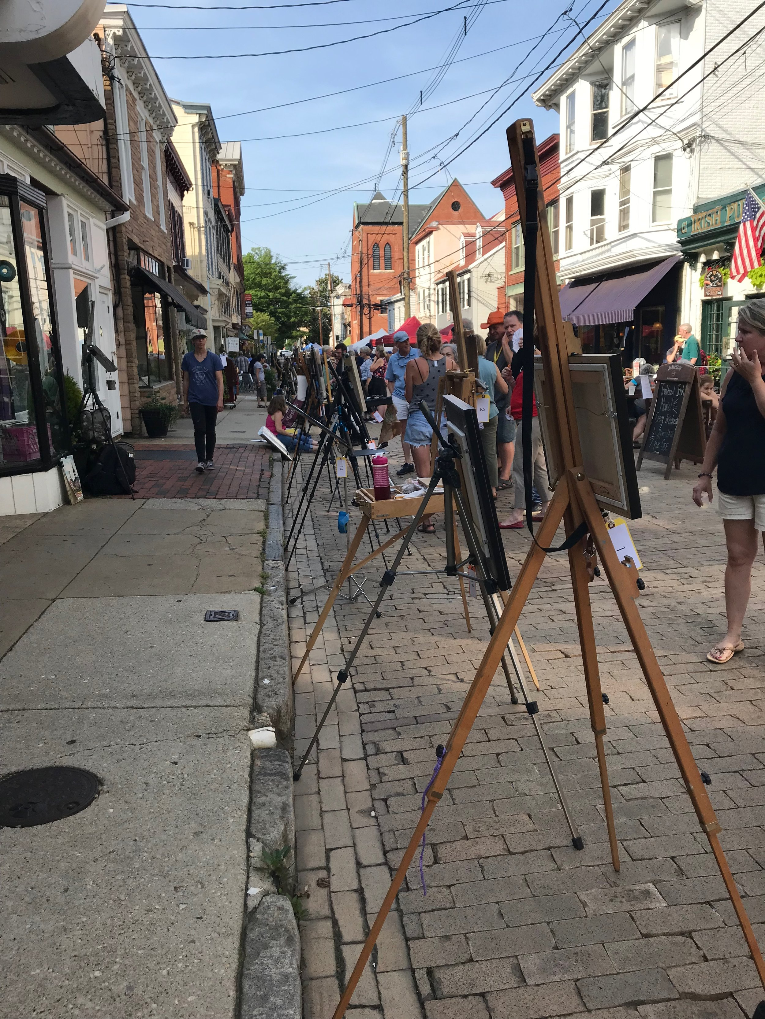 Easels lined up for display at Art on the Avenue in Annapolis, MD