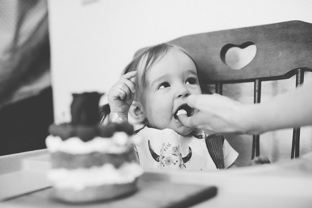 To get her to eat the cake, I had to take a bite of the frosting first and then feed it to her. She was still unsure of what to think until the third bite. Then, she figured out that sugar was good and you can guess what happened next....frosting everywhere!