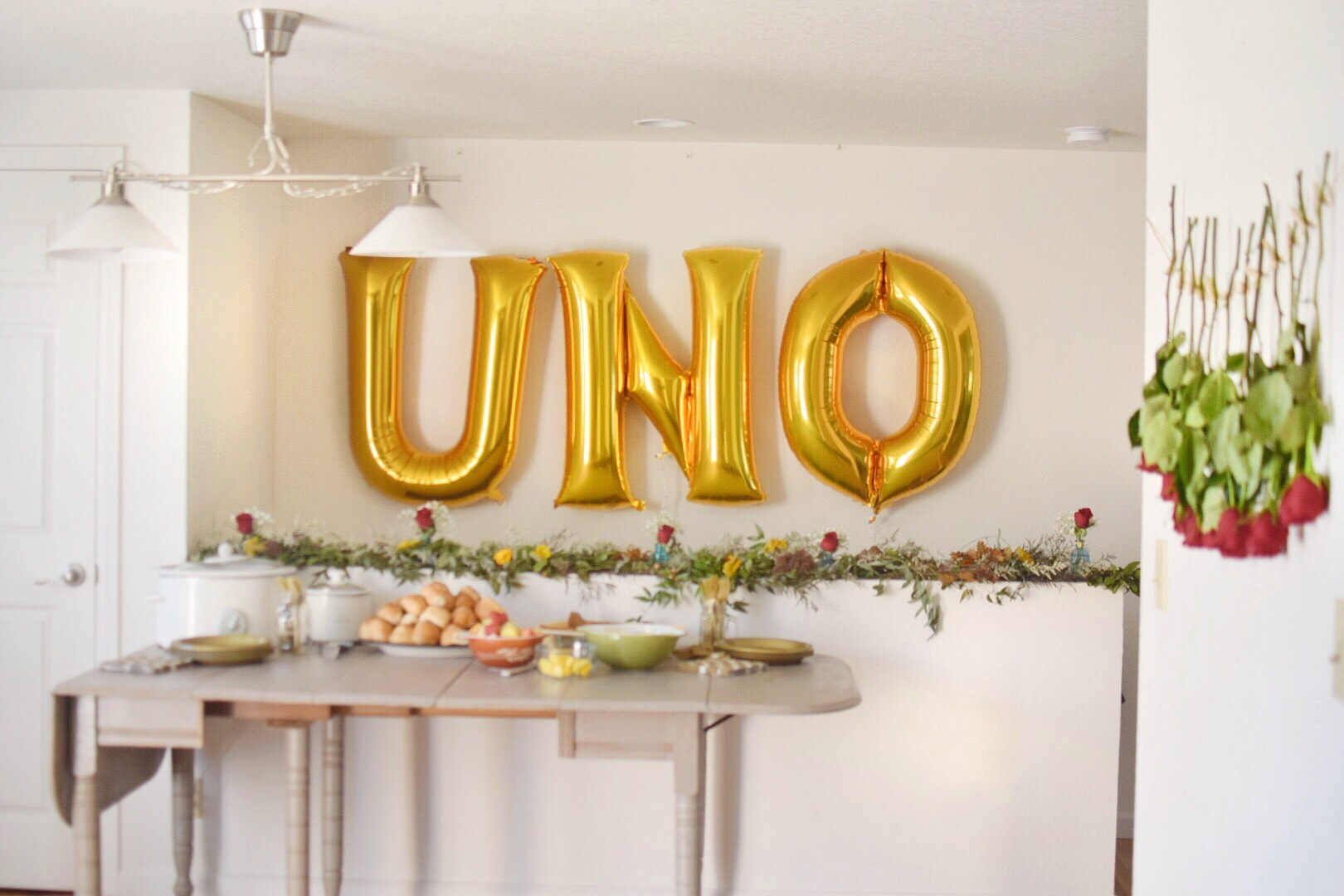 A first birthday party idea: Get large balloons to make a statement! To make things easy on us, we had a pot luck with breakfast goodies complete with a Bloody Mary bar. I think we earned those drinks! The first year of raising a human is no joke :)