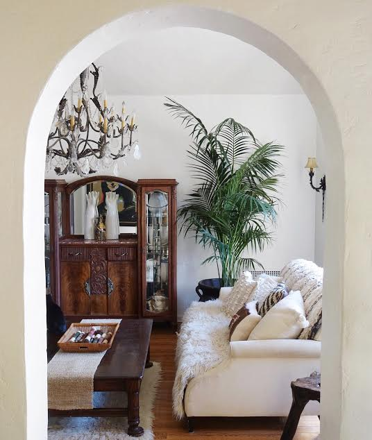 A potted palm anchors the sitting room.