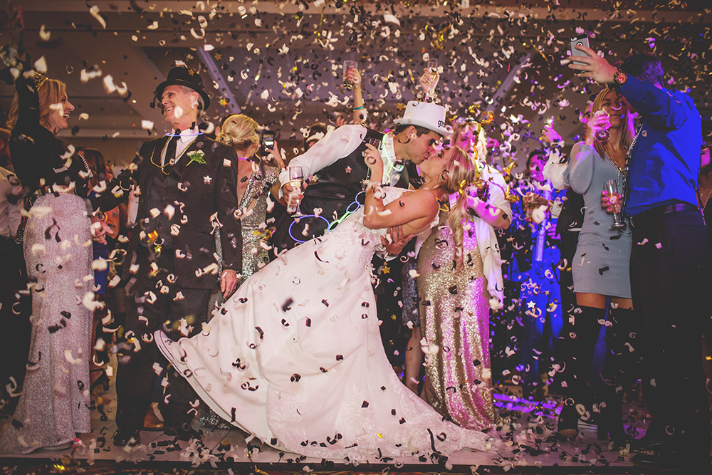 NYE wedding - If you are looking for a wedding photographer you will want to use Maggie. She is so easy to work with and will take any pictures you request - plus many more! You will be so happy with your wedding photos. Her turn around time is amazingly quick and the quality of her work will not disappoint. You will be thrilled with her work. She did my daughters wedding and we couldn't be happier. We love her photos!
