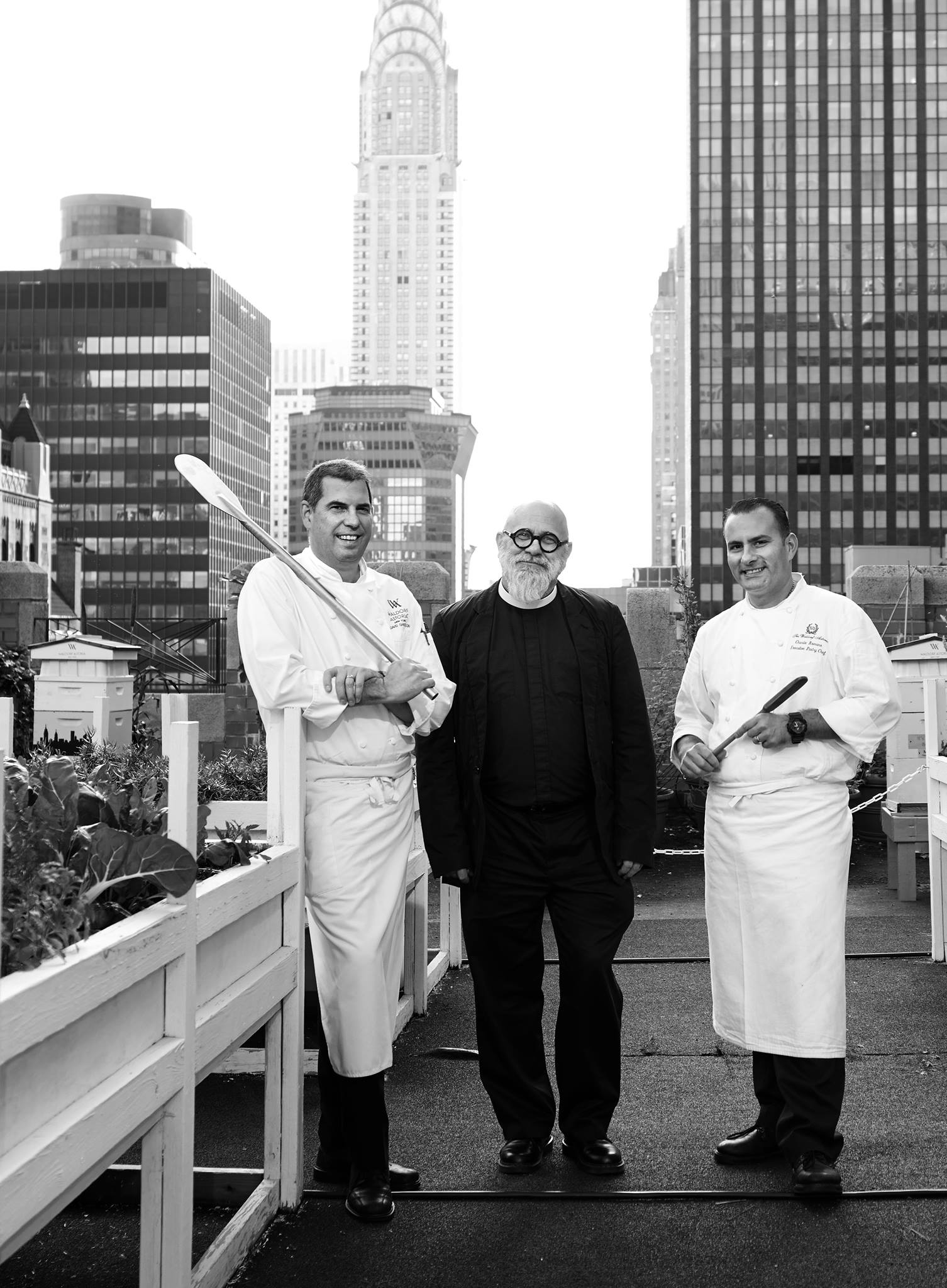 Chef David Garcelon, Director of Culinary, Edward Sunderland, Director of Crossroads, and Charles Ramono, Executive Pastry Chef, on the rooftop garden of the Waldorf Astoria New York selecting ingredients for the Fare Share Friday poster photo shoot. November 2014