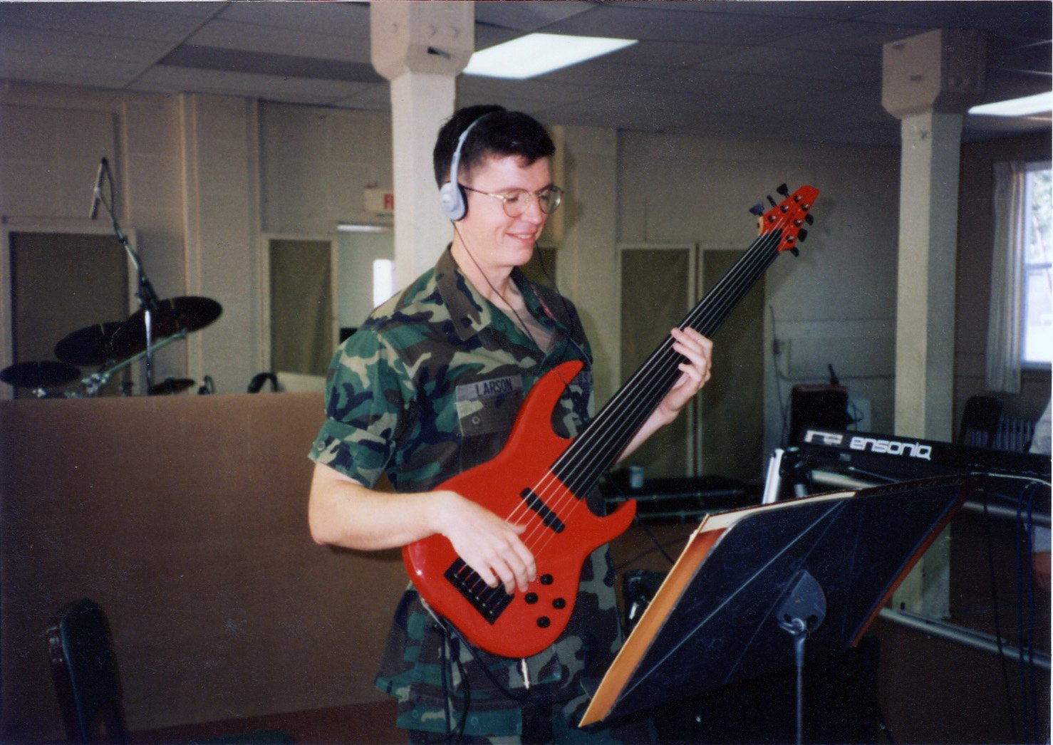 SPC Larson rocking the fretless 6-string bass for the US Army circa 1984.