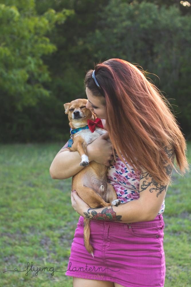 owner cuddling dog standing up