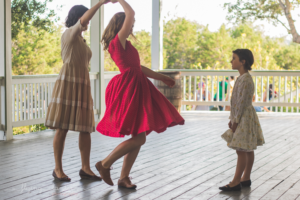 mother twirling daughters