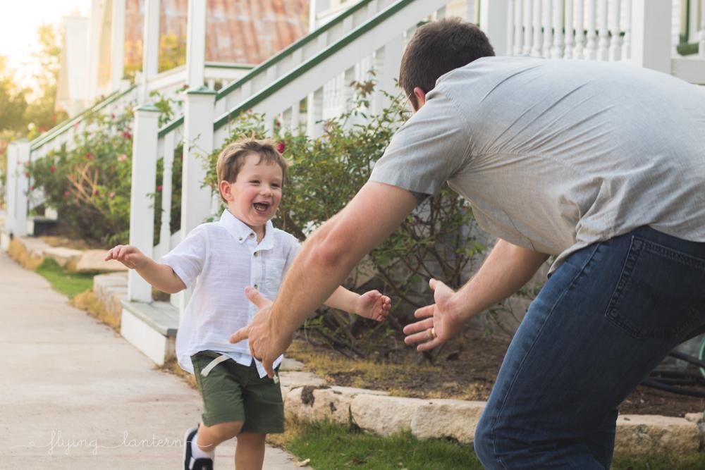 three year old boy running to dad