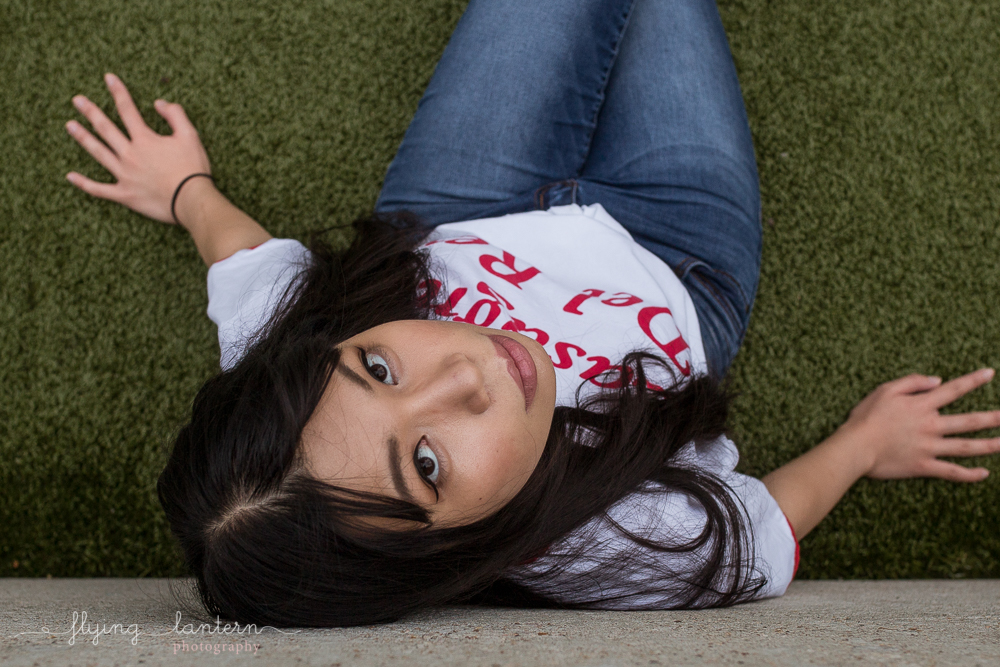 girl portrait in austin, texas at seaholm district wearing jeans photo by erin reas of flying lantern photography