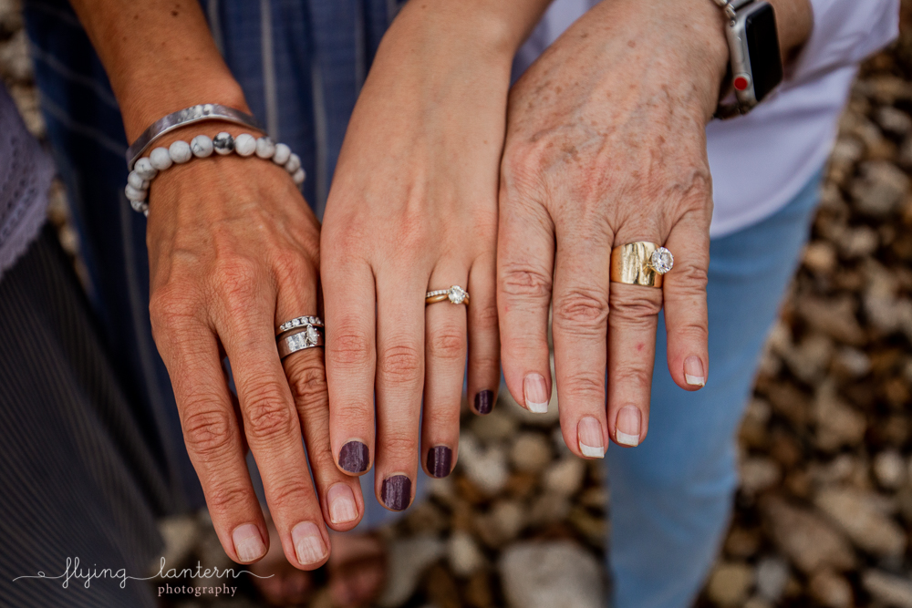 Three generations of Ellis women hands. Extended family portrait session in Kingsland, TX. Photo by Erin Reas of Flying Lantern Photography