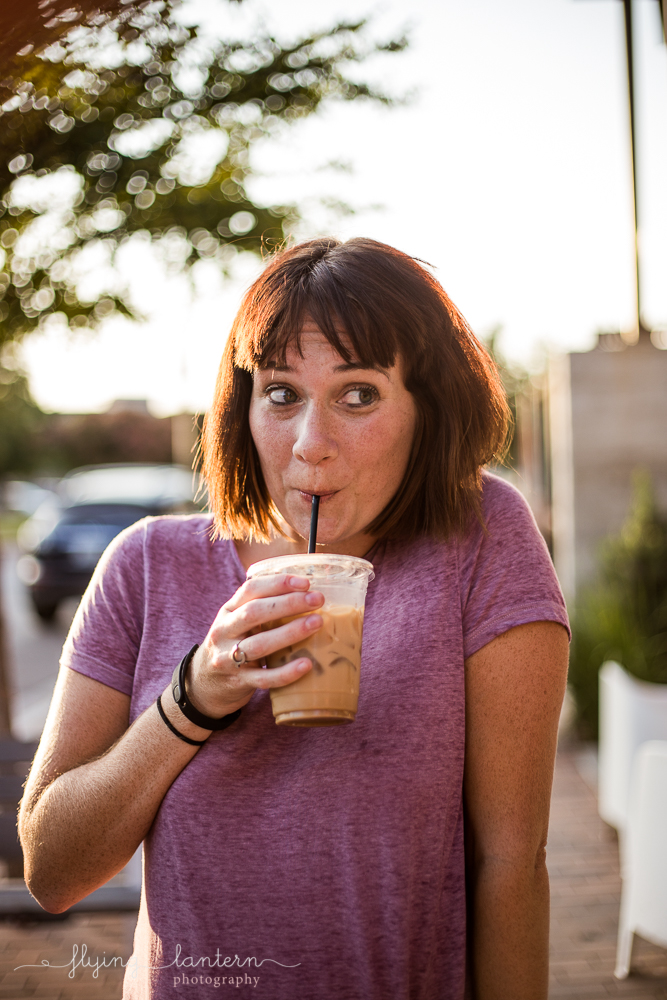 Austin blogger outside Halcyon holding coffee and making facial expressions