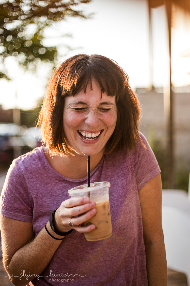 Austin blogger outside Halcyon holding coffee and laughing