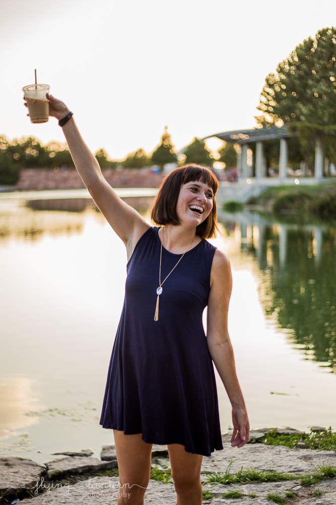 Austin blogger at mueller lake park lifestyle portrait holding coffee in air photography by Erin Reas of Flying Lantern Photography