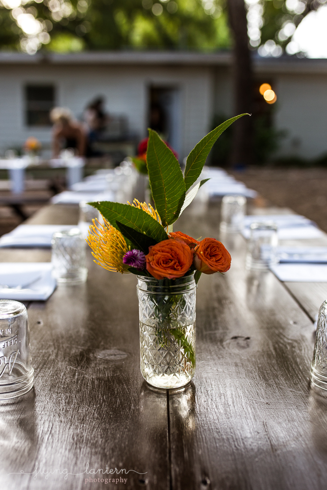 Flower arrangement with wildflowers in mason jar at Wander/Gather event at Eden East in Austin, TX. Photo by Erin Reas of Flying Lantern Photography.