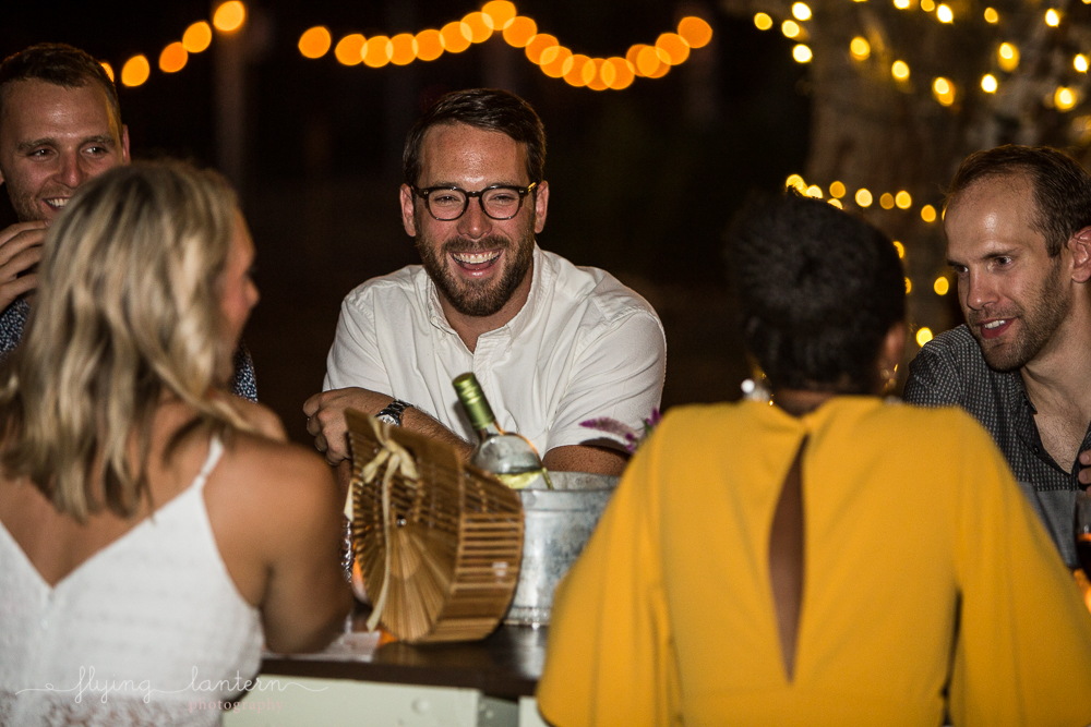 Male guest laughing at dinner party. Event Photography by Erin Reas of Flying Lantern Photography