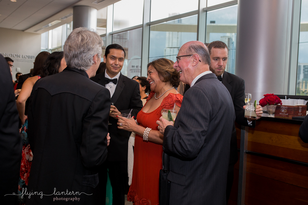 Guests laughing at the Authentic Mexico Gourmet Gala. Event photography by Erin Reas of Flying Lantern Photography
